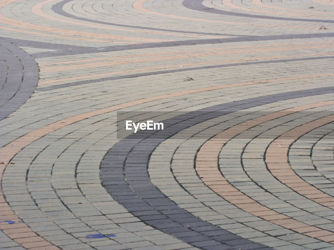 pattern, high angle view, no people, full frame, curve, day, backgrounds, outdoors, shape, nature, geometric shape, circle, footpath, white color, design, sport, textured, street, repetition, absence, paving stone