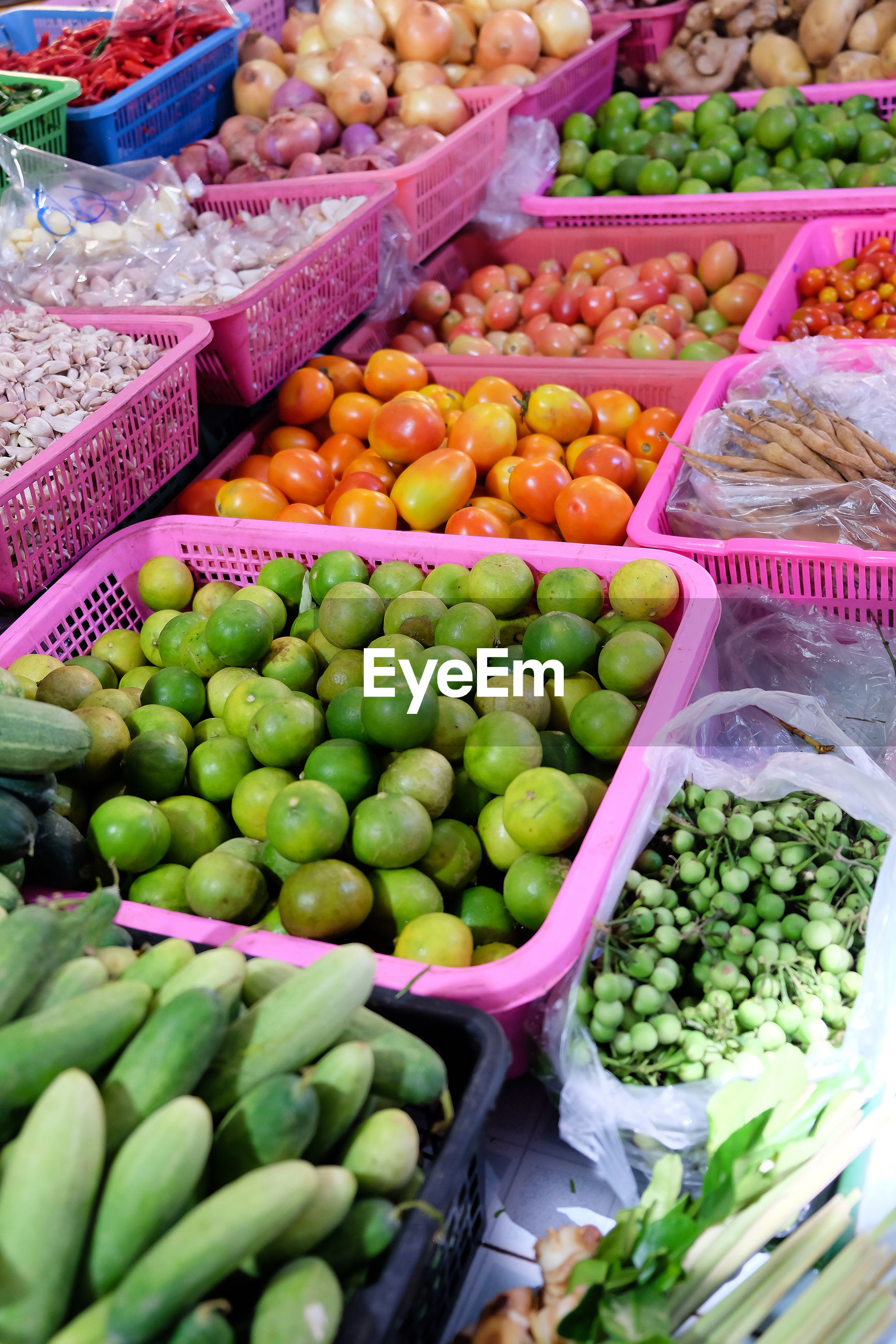 HIGH ANGLE VIEW OF FRUITS FOR SALE IN MARKET STALL
