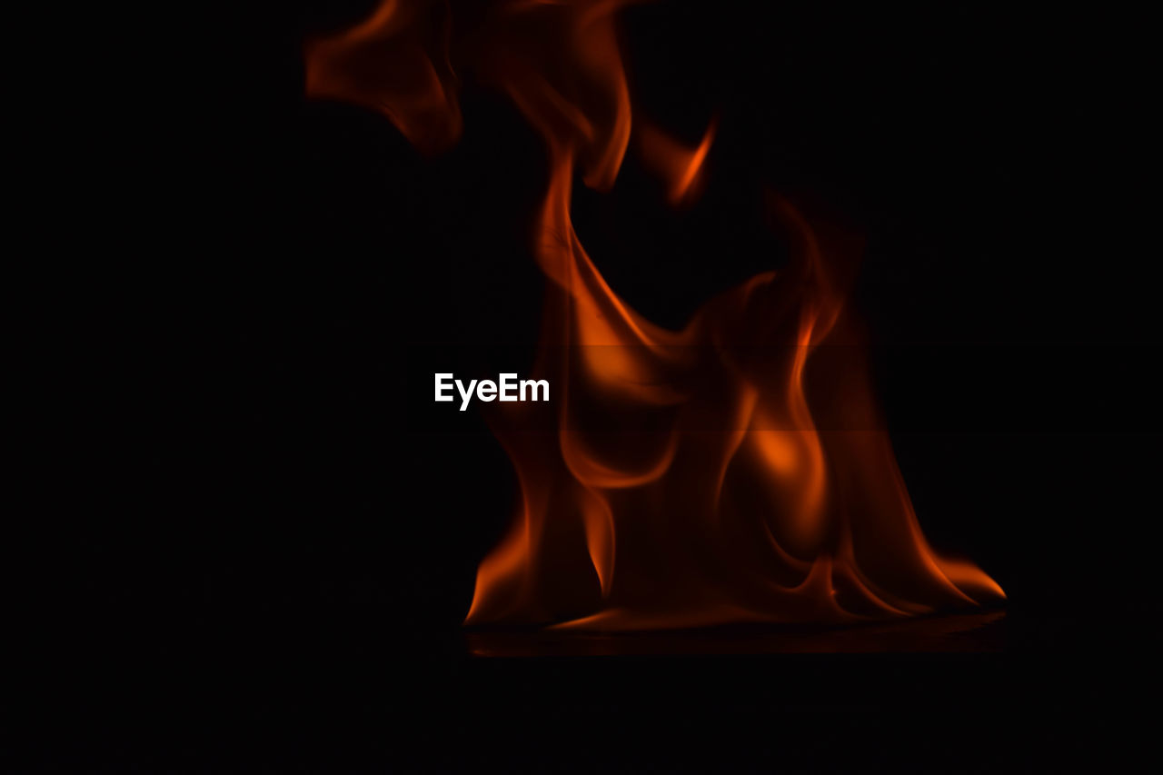 burning, flame, heat - temperature, black background, motion, studio shot, no people, close-up, smoke - physical structure, night, indoors
