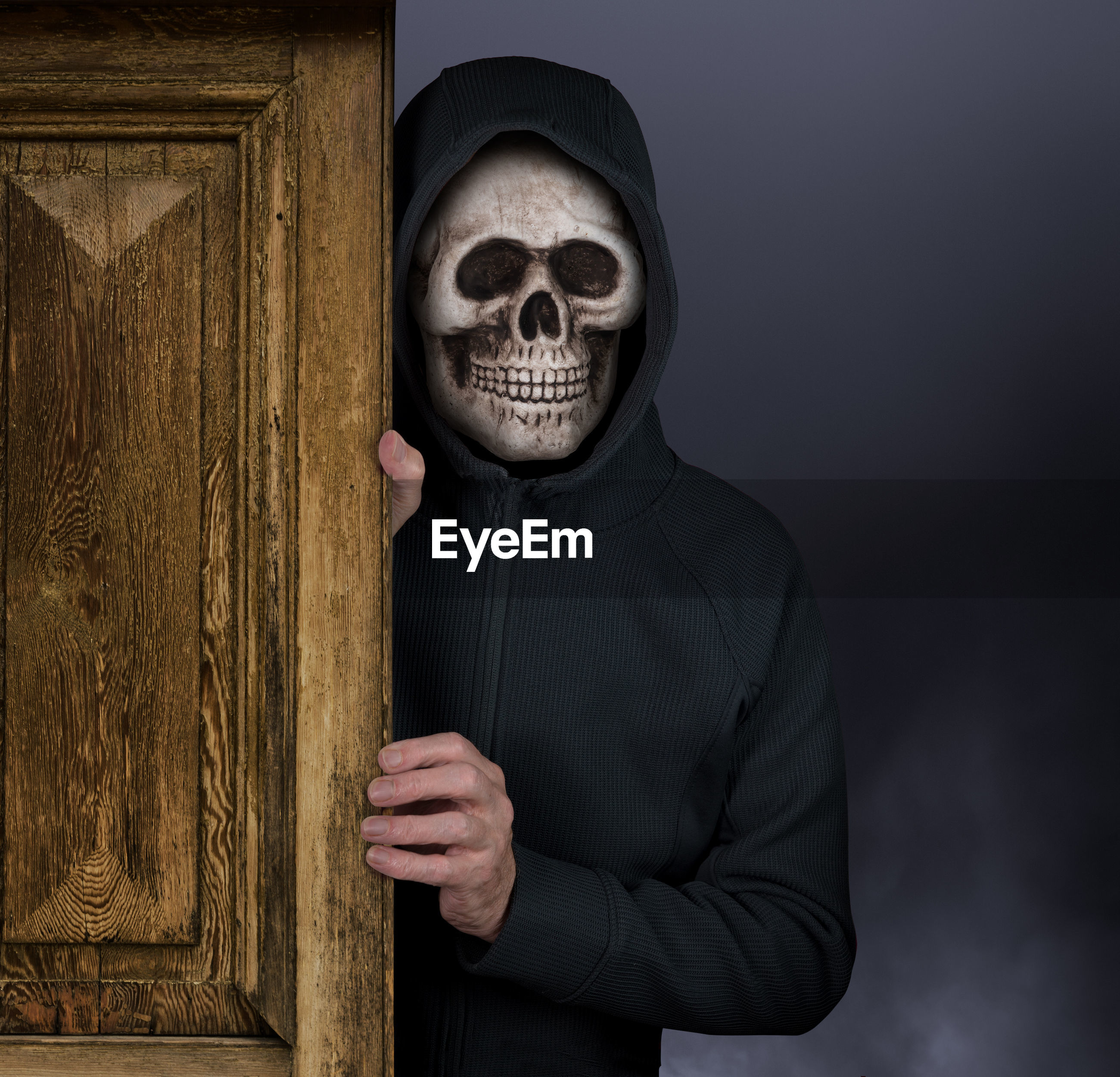 Man wearing skull mask