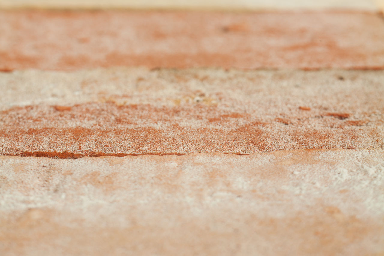 backgrounds, textured, full frame, no people, pattern, brown, close-up, selective focus, land, day, wall - building feature, outdoors, copy space, marble, nature, flooring, rough, built structure, abstract, architecture, abstract backgrounds, concrete, blank, surface level, textured effect