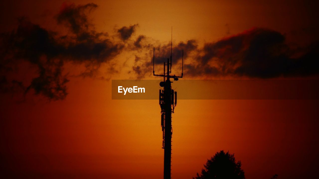 sunset, silhouette, orange color, technology, tree, nature, sky, outdoors, connection, no people, communication, beauty in nature, scenics, low angle view, antenna - aerial, television aerial, telecommunications equipment, wireless technology, day