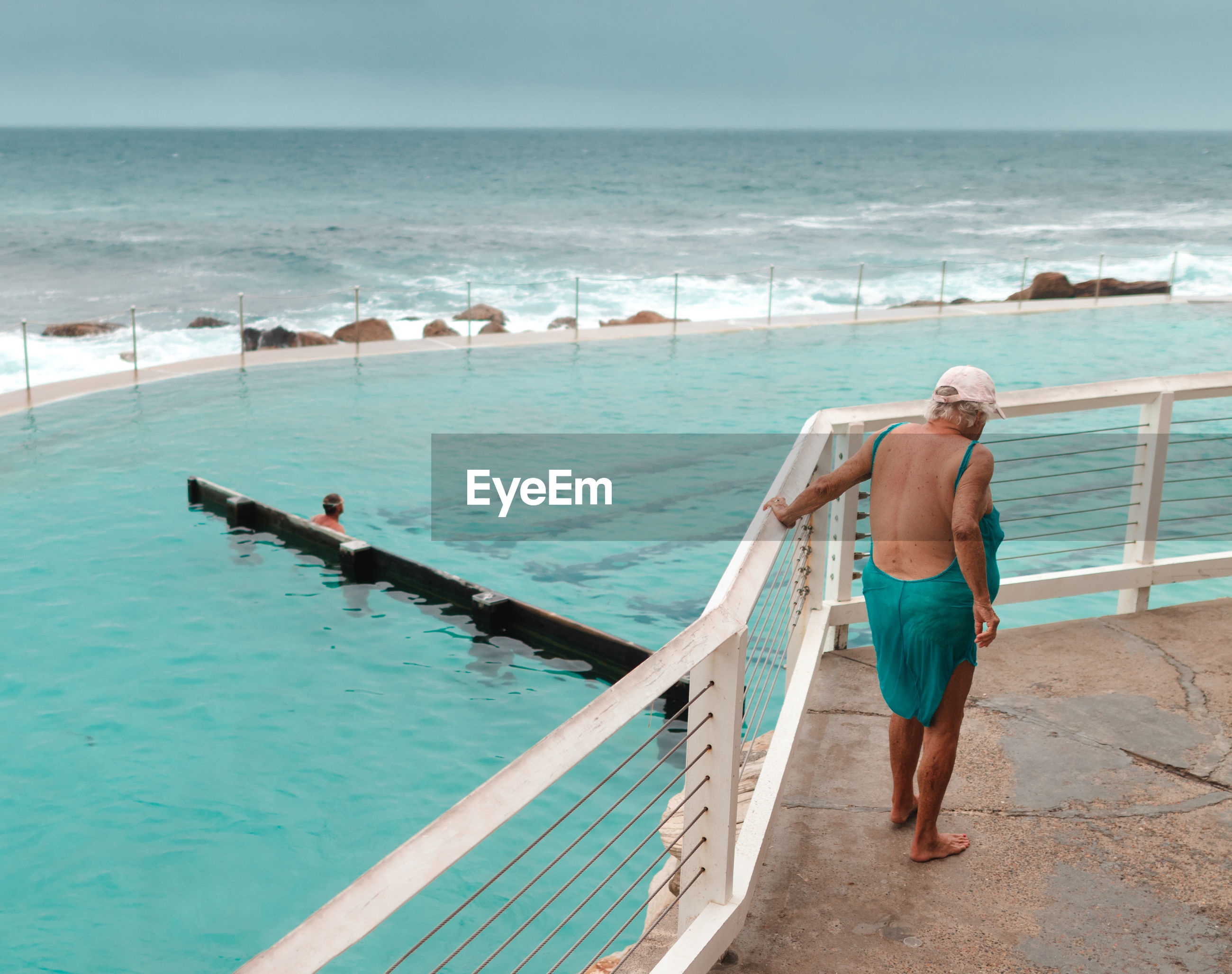 REAR VIEW OF MEN AT BEACH