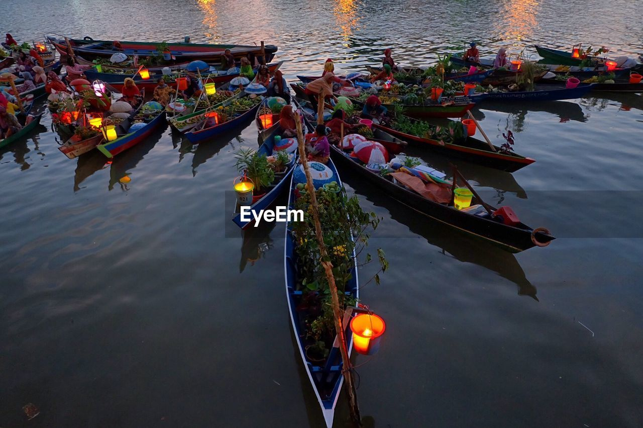 High Angle View Of Vendors In Boats On River