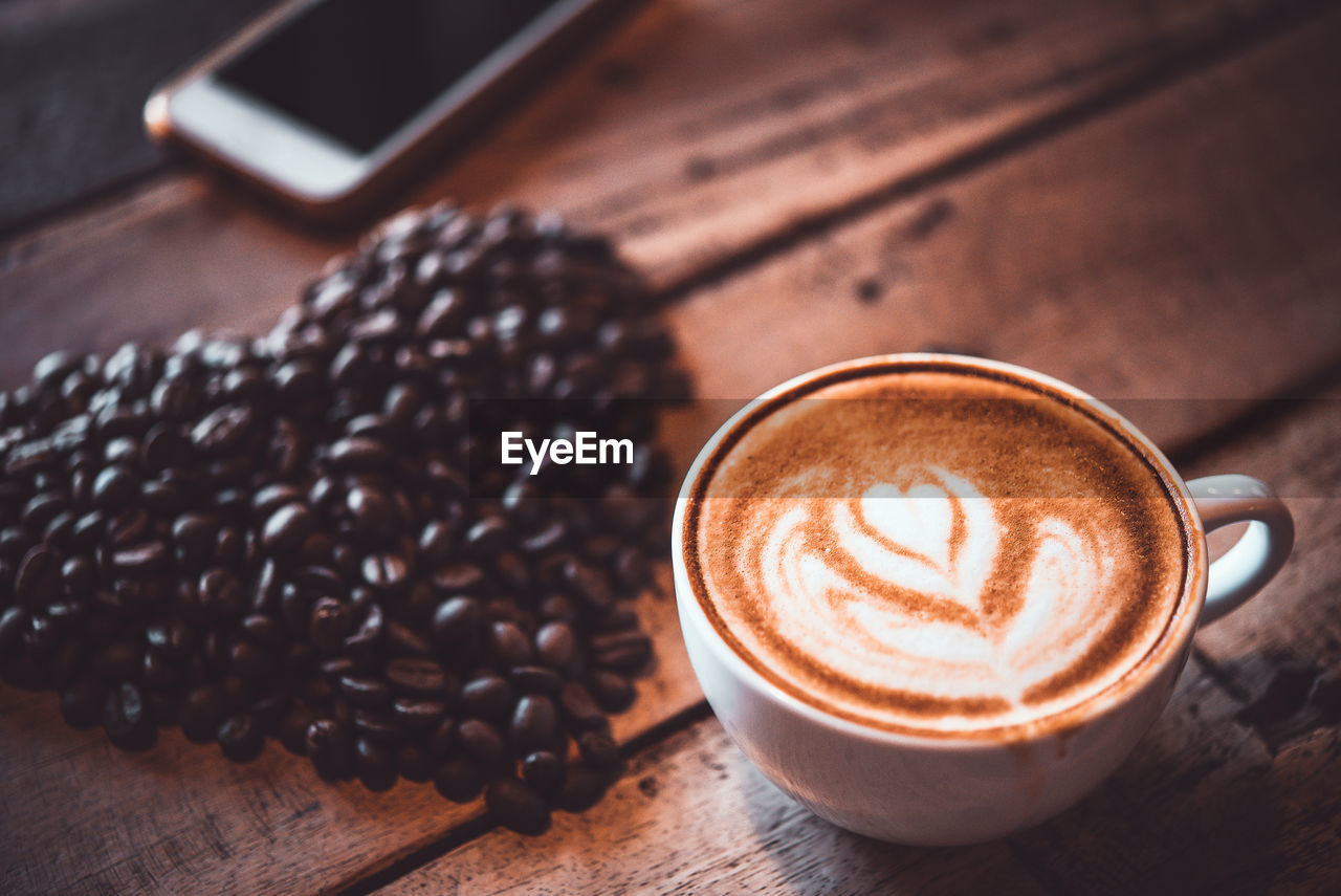 coffee, food and drink, coffee - drink, refreshment, drink, still life, coffee cup, cup, table, mug, cappuccino, frothy drink, froth art, food, freshness, hot drink, indoors, no people, cafe, high angle view, crockery, latte, coffee shop, non-alcoholic beverage