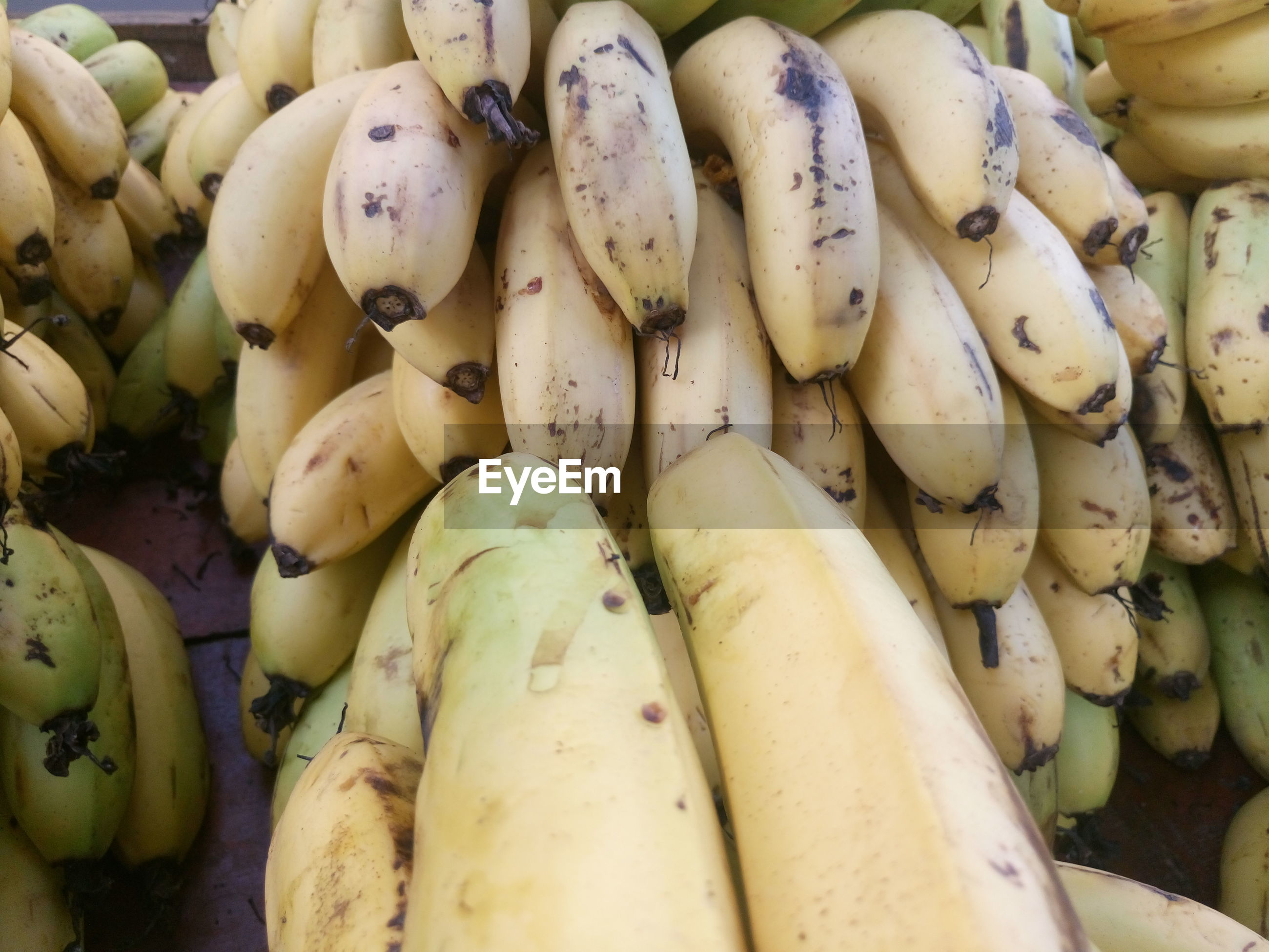 High angle view of bananas at market for sale