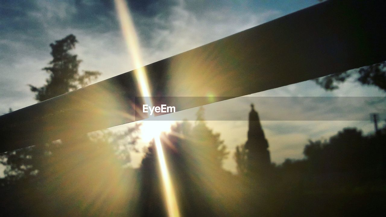 sunbeam, sun, lens flare, sunlight, sky, no people, tranquility, nature, outdoors, day, cloud - sky, silhouette, low angle view, sunset, beauty in nature, tree, scenics, close-up