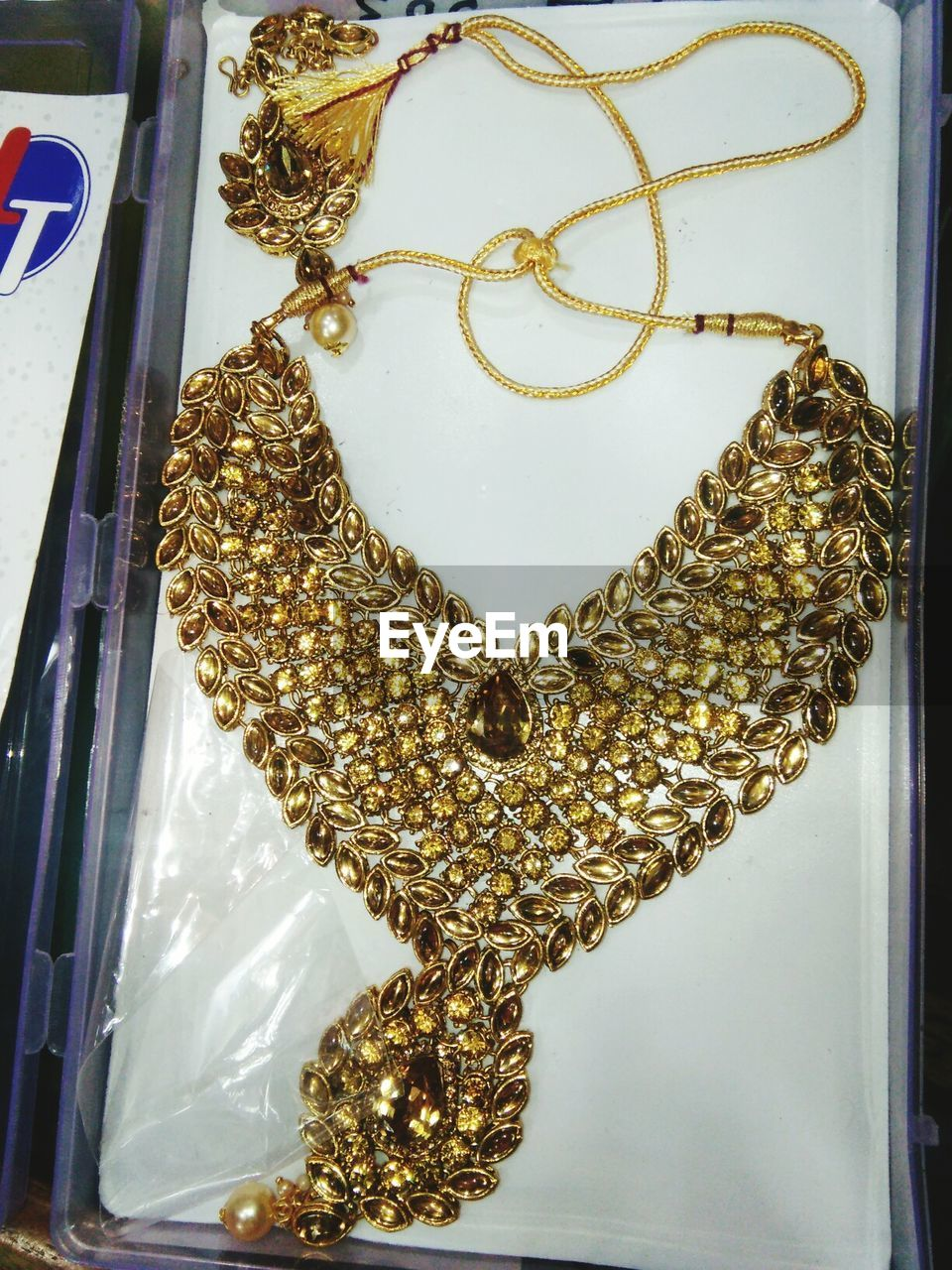 jewelry, gold colored, necklace, luxury, no people, close-up, indoors, gold, hanging, day