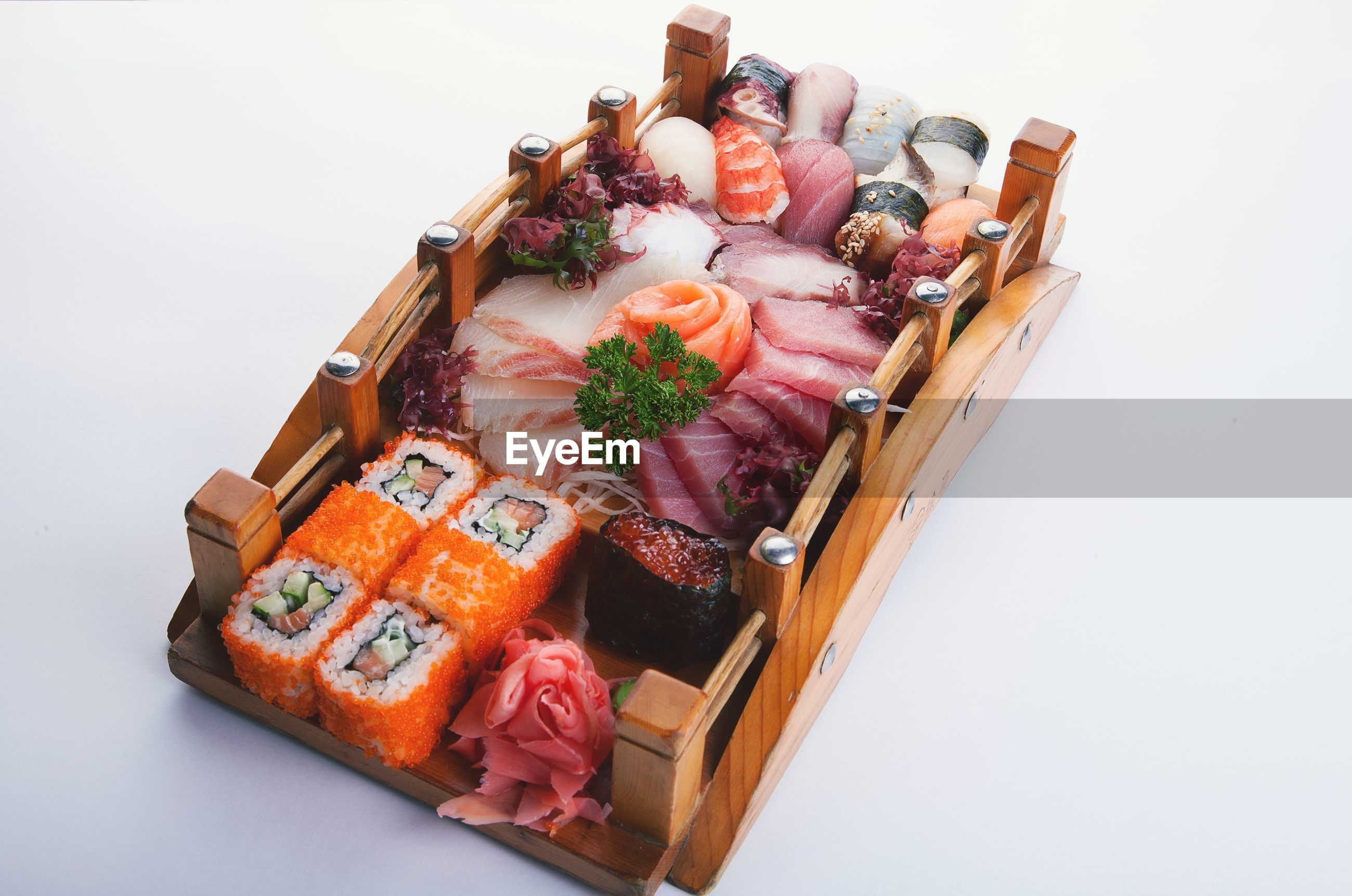High angle view of seafood on wood against white background