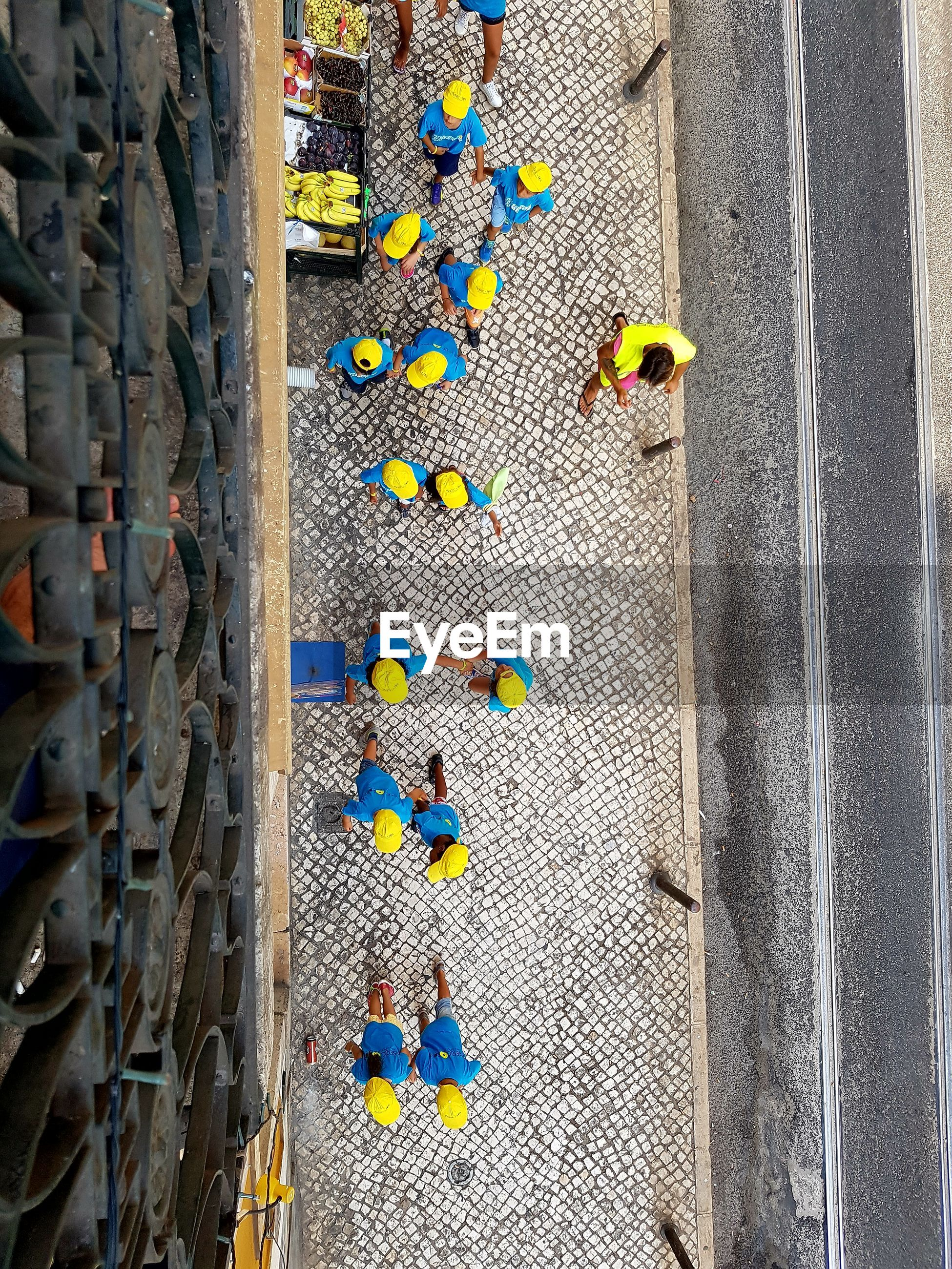 Directly above shot of people on sidewalk