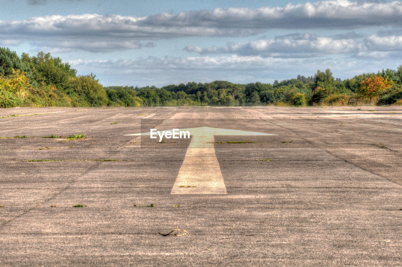 asphalt, transportation, cloud - sky, airport runway, day, sky, the way forward, tree, outdoors, airplane, no people, airfield, aerospace industry, road, nature