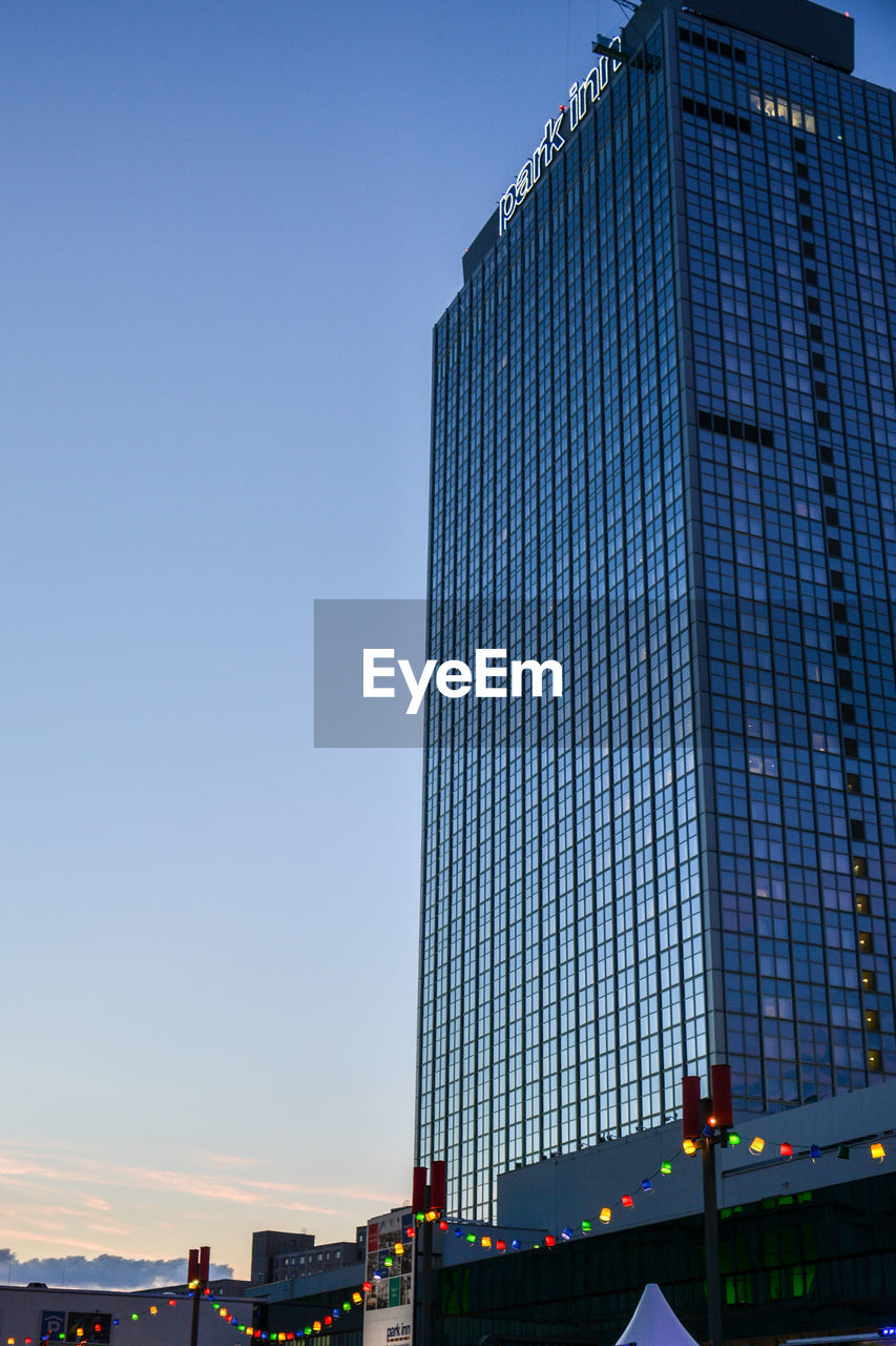 architecture, built structure, skyscraper, building exterior, low angle view, modern, city, clear sky, blue, day, outdoors, sky, no people, cityscape