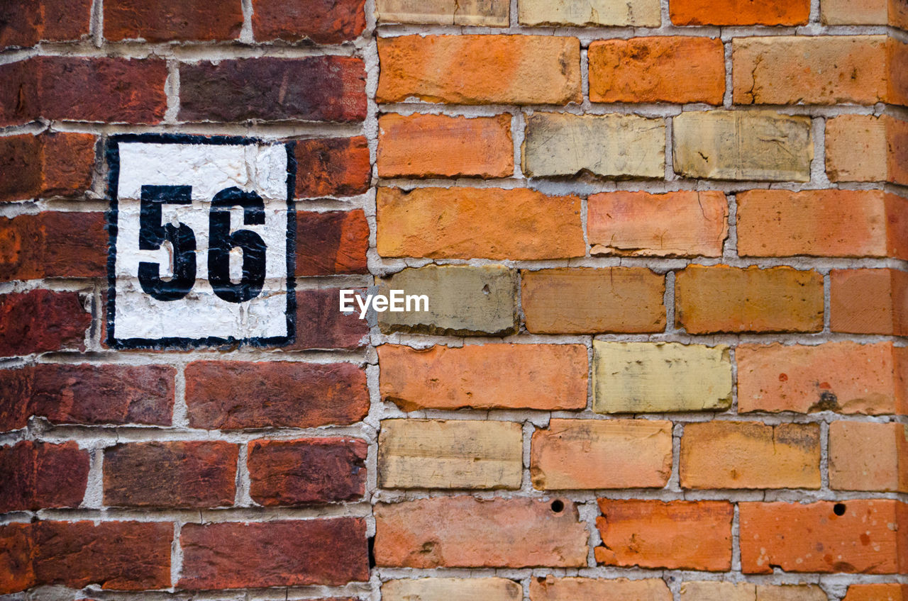 brick wall, brick, wall, built structure, wall - building feature, architecture, no people, pattern, red, text, day, close-up, textured, full frame, backgrounds, communication, western script, outdoors, building exterior, in a row