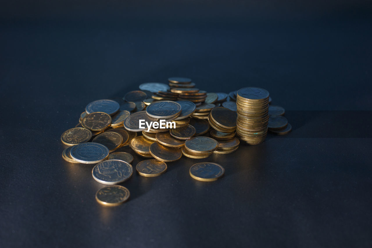 coin, finance, wealth, business, savings, metal, large group of objects, indoors, currency, still life, stack, studio shot, finance and economy, high angle view, close-up, economy, selective focus, arrangement, abundance, business finance and industry, no people, black background