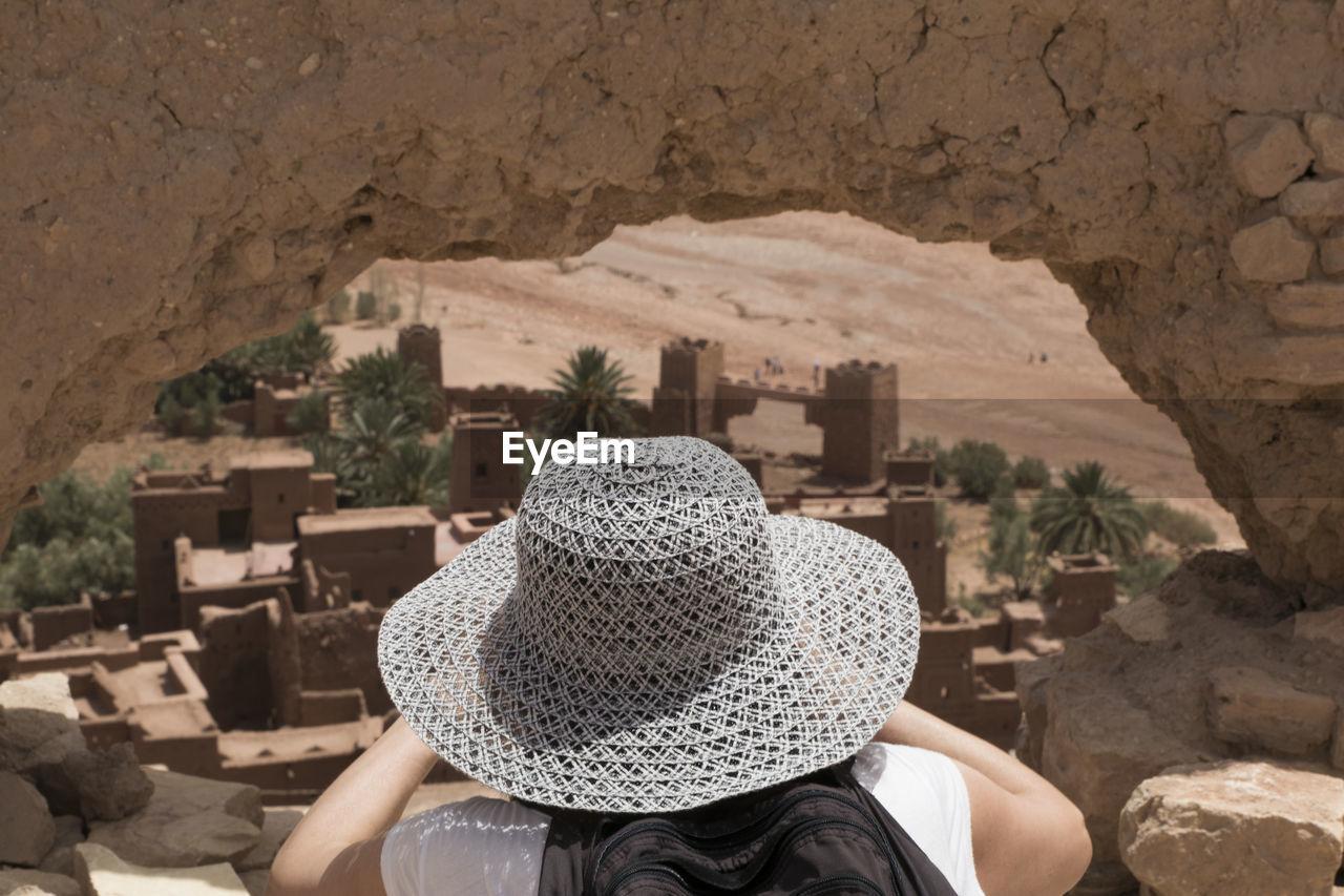 Woman In Straw Hat On Rock