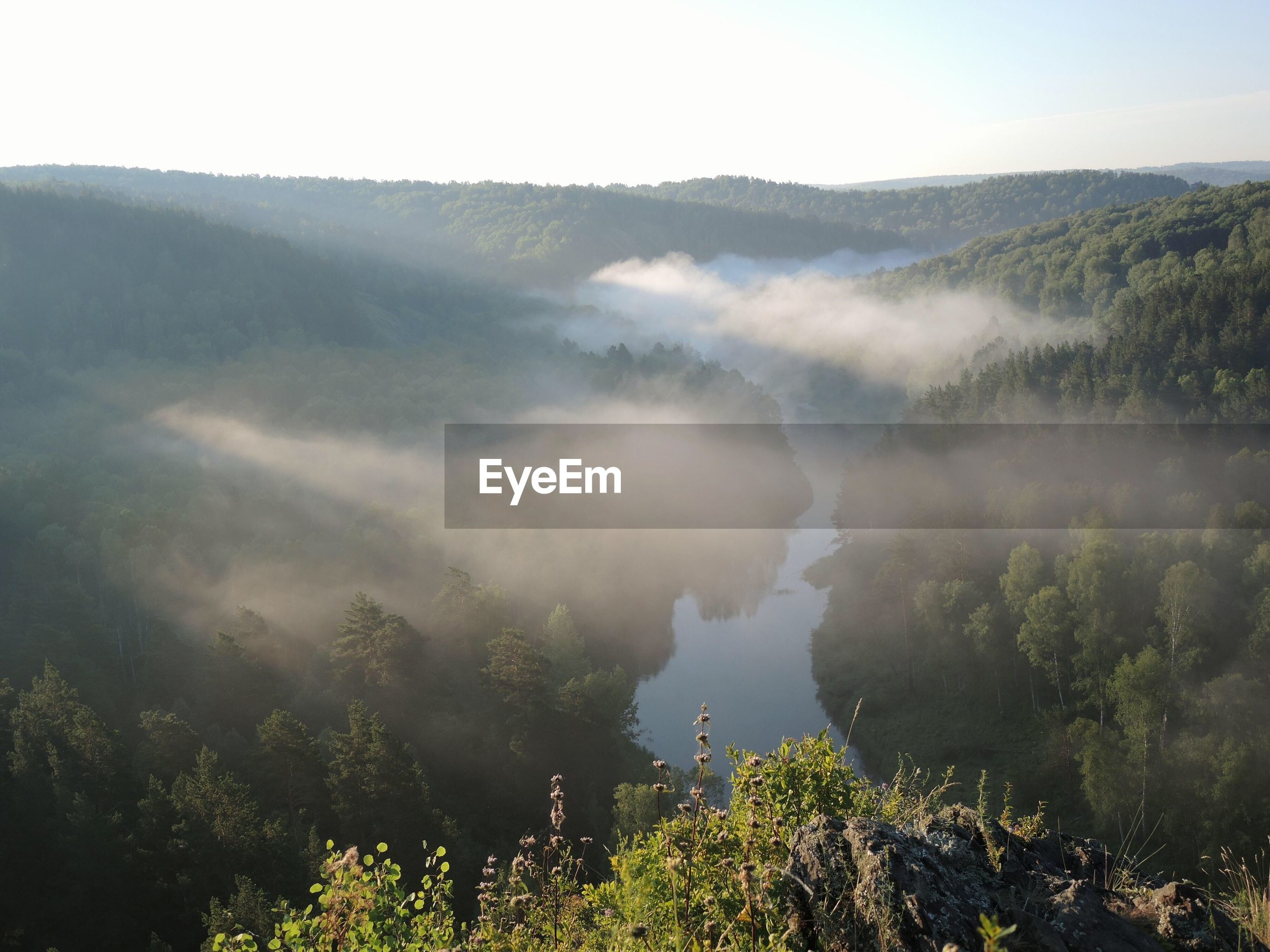 High angle view of lake in foggy weather