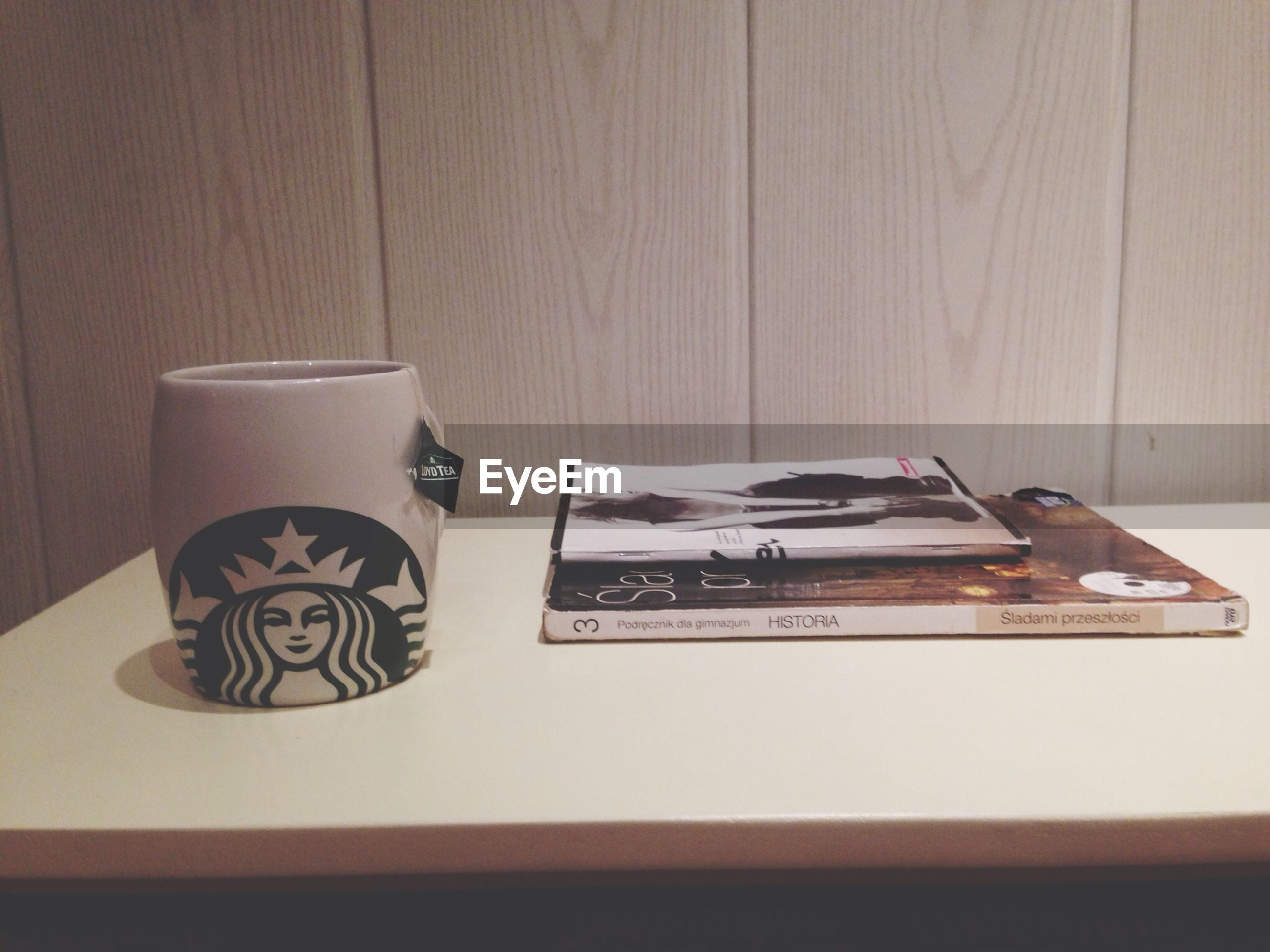 indoors, table, still life, wood - material, home interior, high angle view, coffee cup, close-up, no people, book, absence, technology, wall - building feature, communication, old-fashioned, domestic room, paper, empty, chair, pen
