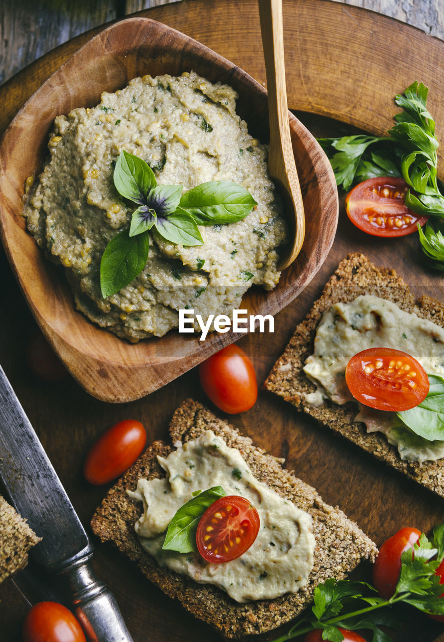 food, food and drink, healthy eating, freshness, fruit, vegetable, tomato, wellbeing, bread, indoors, ready-to-eat, kitchen utensil, directly above, no people, eating utensil, table, herb, still life, wood - material, cutting board, meal, pizza, vegetarian food, dip