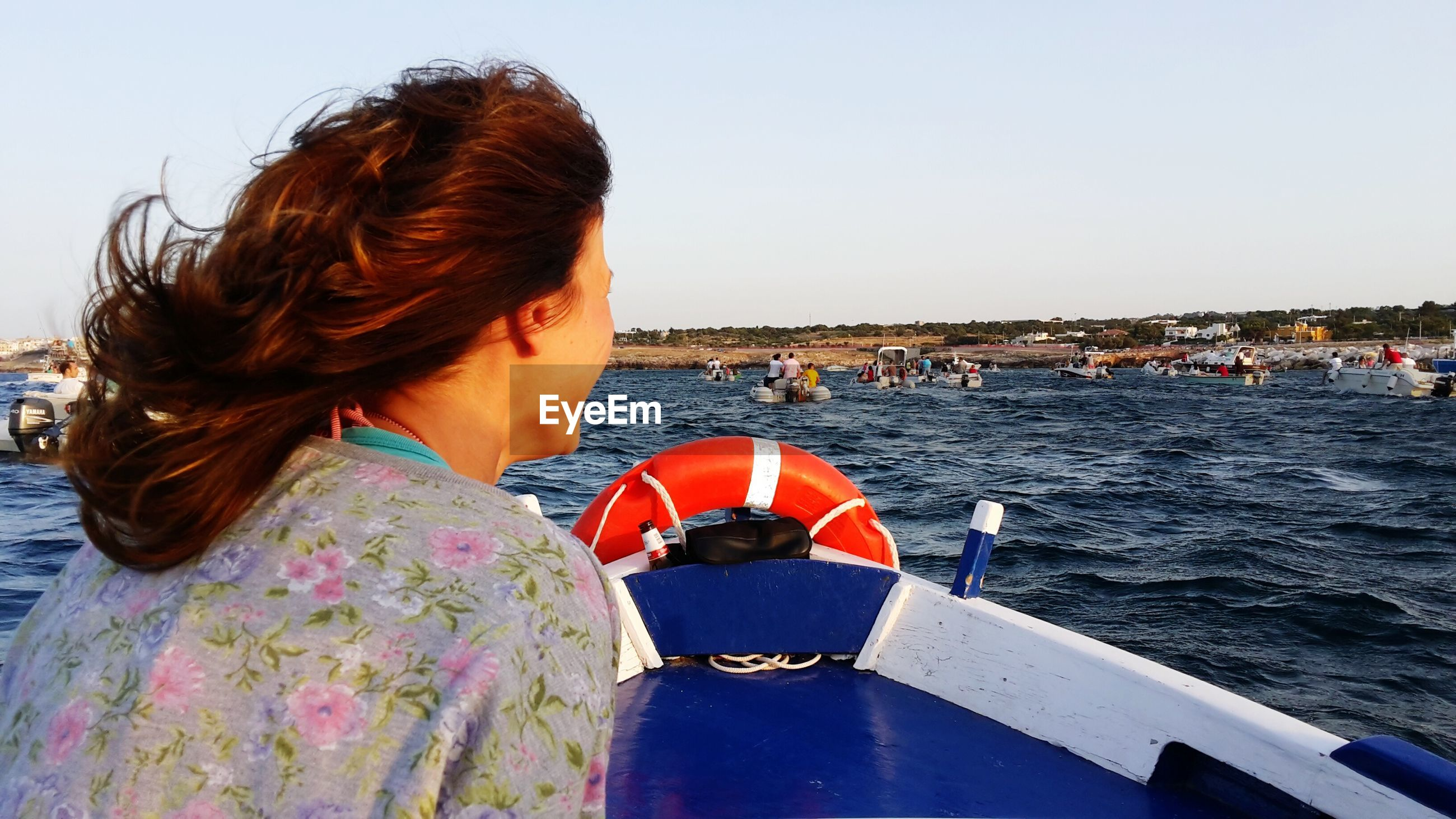 water, lifestyles, sea, leisure activity, person, young adult, clear sky, transportation, young women, nautical vessel, casual clothing, river, long hair, headshot, mode of transport, sunglasses, sky, standing