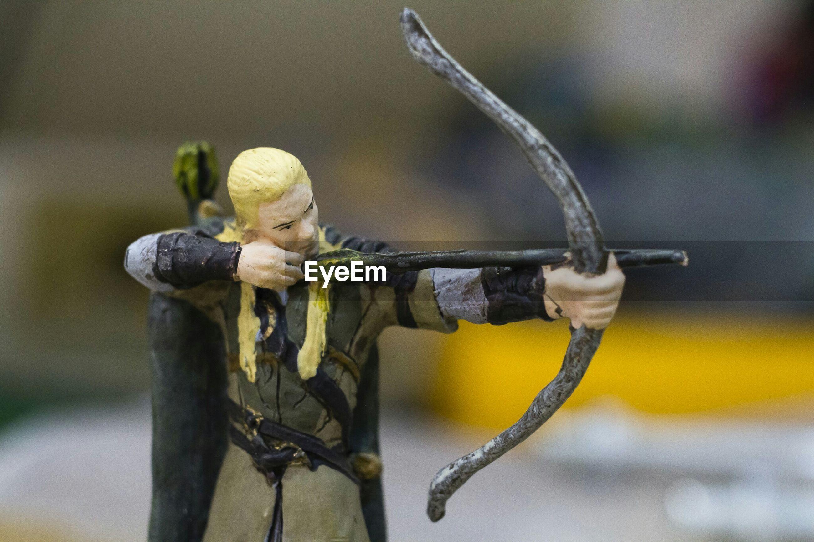 Close-up of archery figurine
