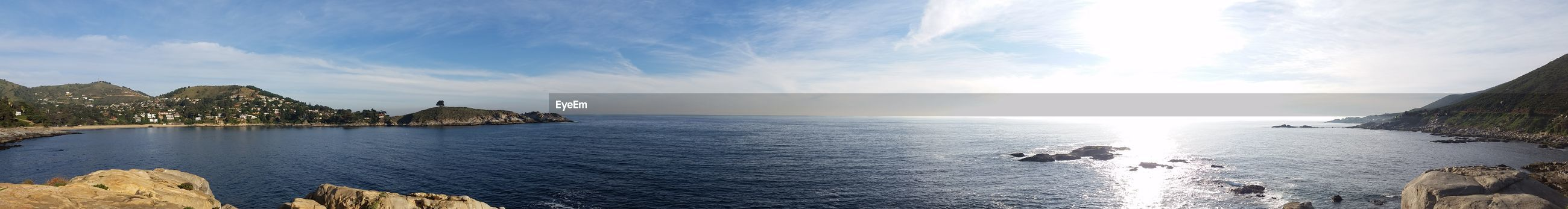water, sea, sky, scenics, tranquil scene, tranquility, beauty in nature, horizon over water, reflection, nature, rock - object, idyllic, cloud - sky, rock formation, cloud, blue, remote, outdoors, rippled, mountain, non-urban scene, day, calm, seascape, no people, sun, travel destinations, tourism, cloudy