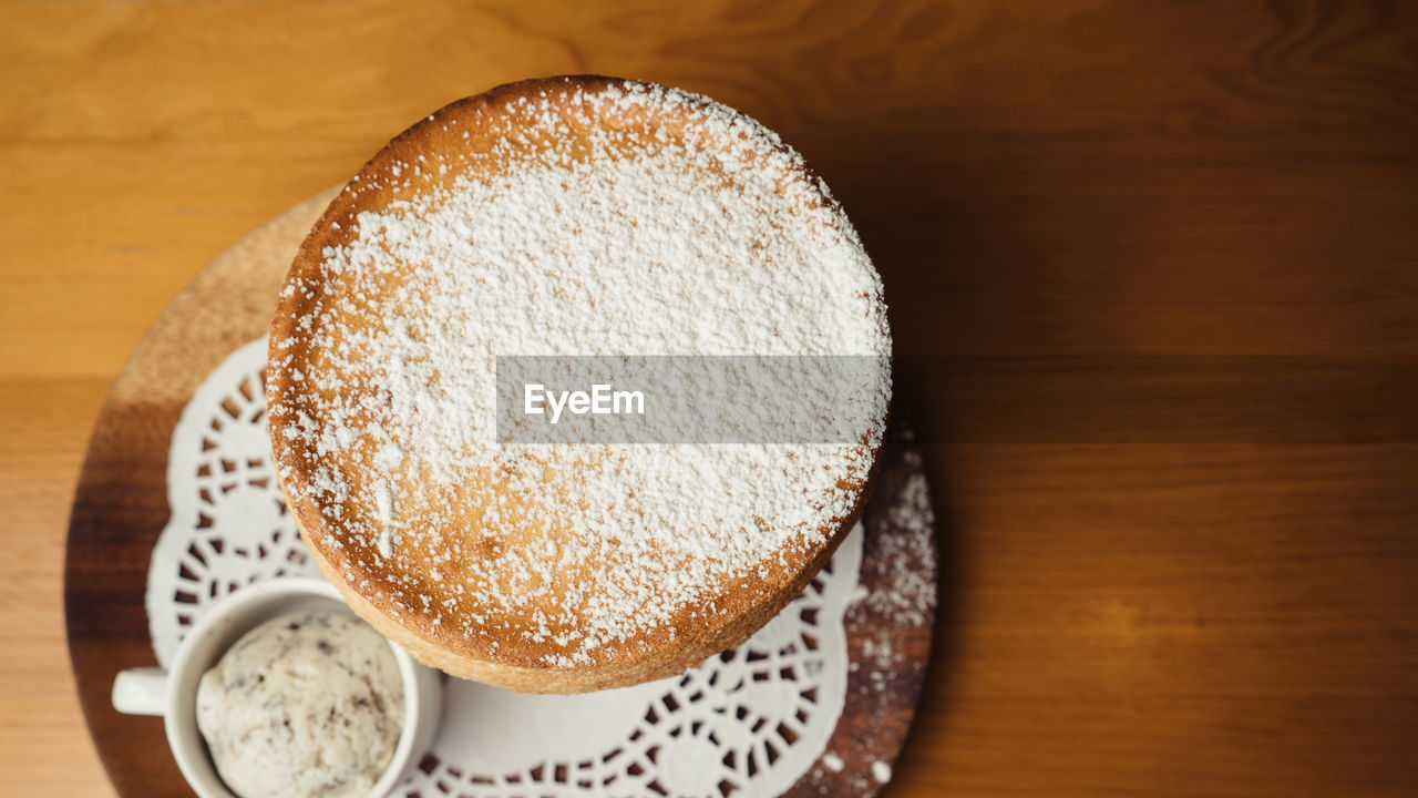 food and drink, food, table, still life, freshness, indoors, sweet food, ready-to-eat, high angle view, close-up, dessert, wood - material, no people, baked, sweet, unhealthy eating, indulgence, cake, temptation, sugar, powdered sugar, snack