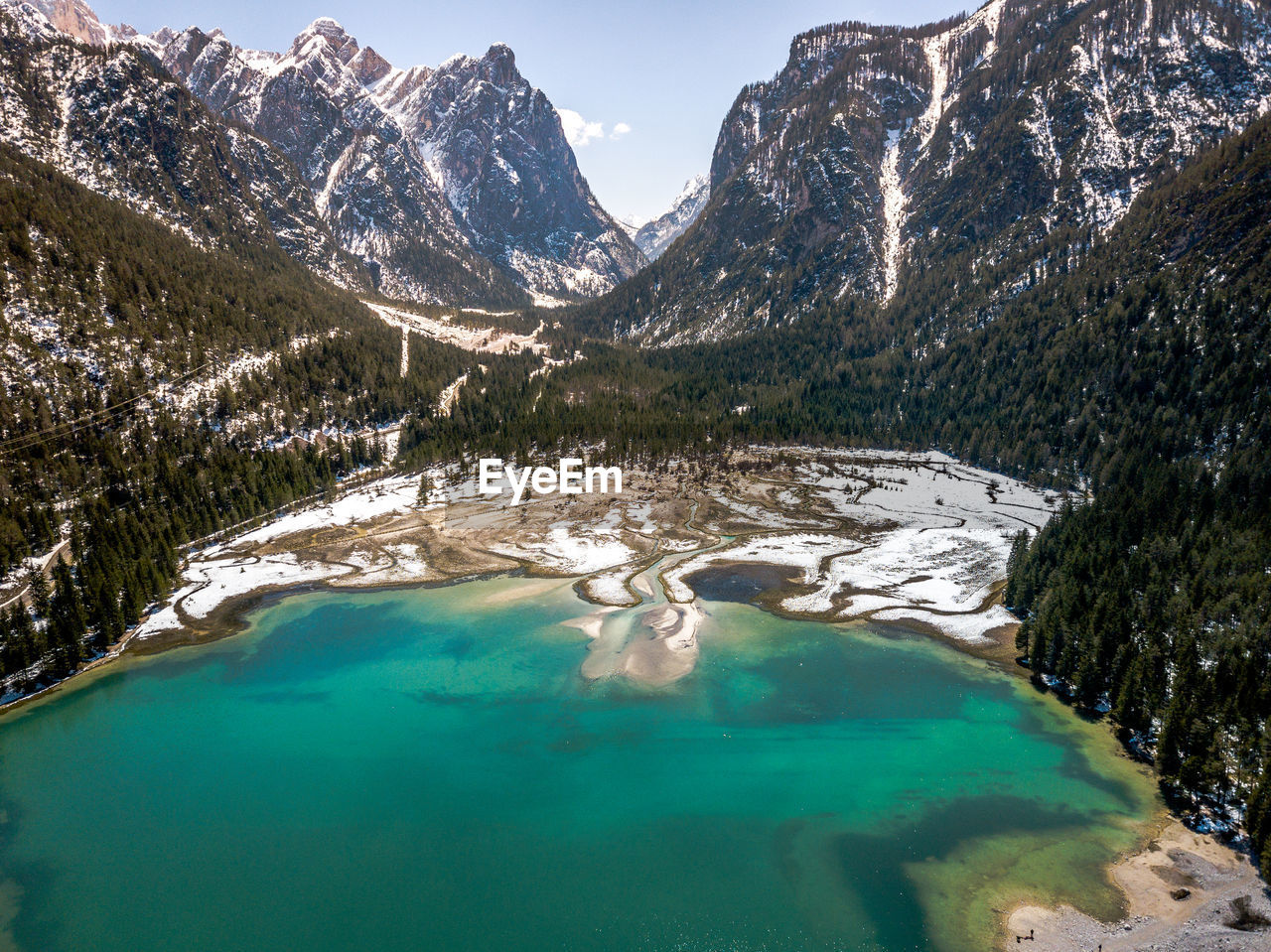 water, mountain, scenics - nature, beauty in nature, tranquility, tranquil scene, lake, mountain range, nature, non-urban scene, idyllic, day, sky, plant, tree, turquoise colored, waterfront, no people, remote, outdoors, snowcapped mountain