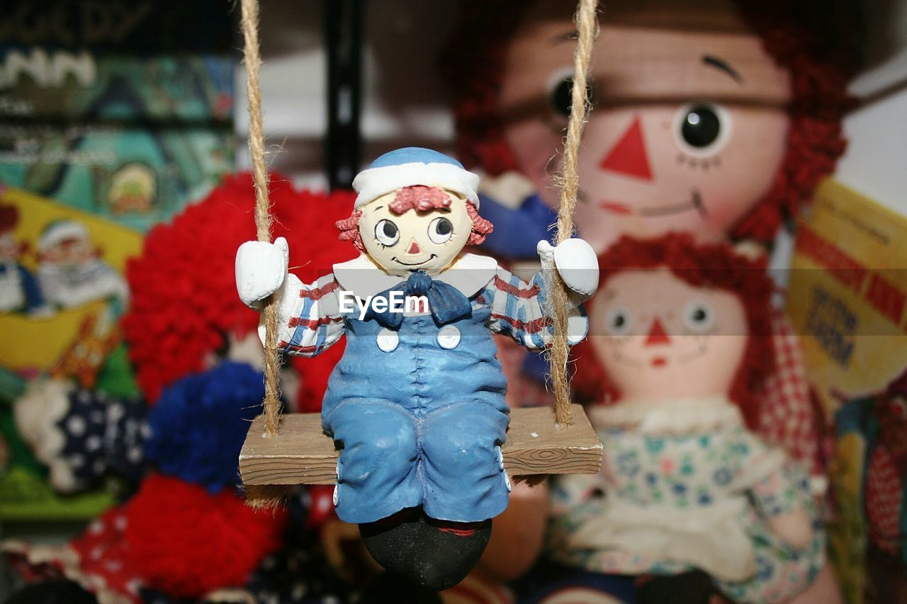 Close-Up Of Toy Sitting On Swing