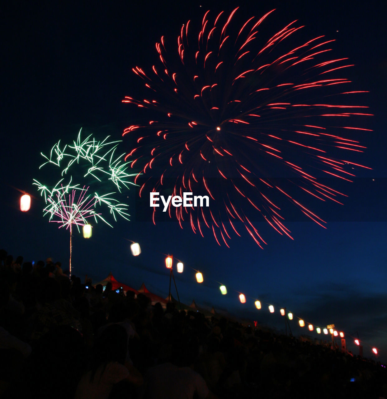 night, firework display, illuminated, celebration, firework - man made object, low angle view, event, long exposure, sky, exploding, motion, glowing, blurred motion, outdoors, arts culture and entertainment, firework, no people, clear sky