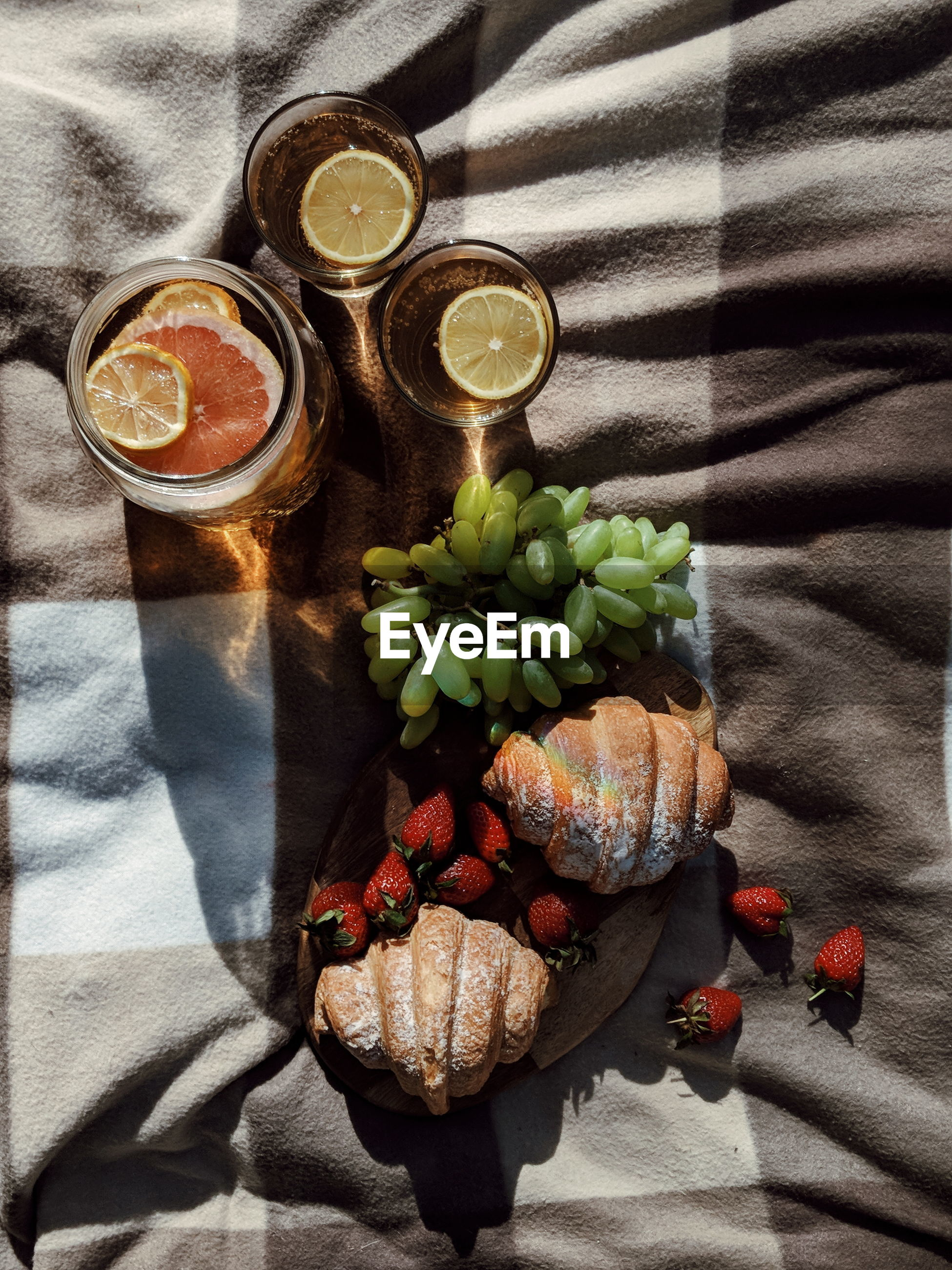 High angle view of drink and food on blanket