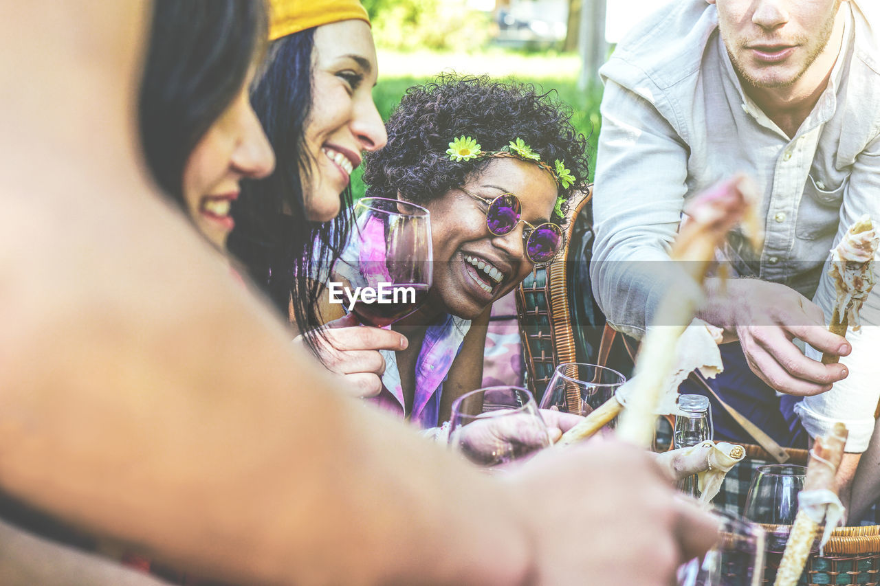group of people, real people, selective focus, smiling, togetherness, women, lifestyles, men, leisure activity, happiness, adult, enjoyment, emotion, bonding, people, young adult, drink, females, positive emotion, glass