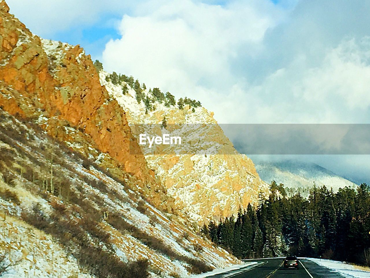 sky, cloud - sky, mountain, beauty in nature, tree, nature, plant, scenics - nature, tranquility, day, tranquil scene, non-urban scene, mountain range, transportation, no people, cold temperature, snow, winter, road, mountain road, outdoors, formation, snowcapped mountain
