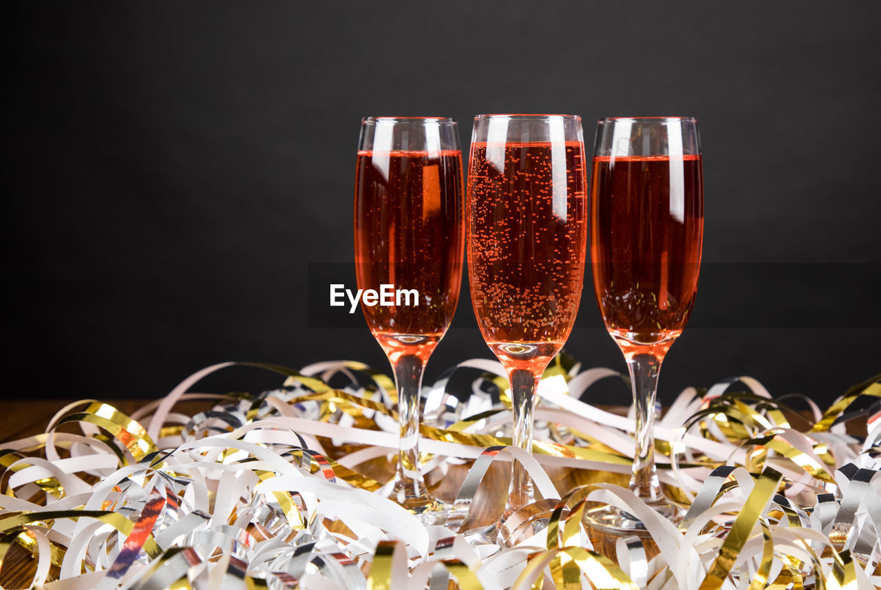 alcohol, refreshment, drink, glass, wine, food and drink, wineglass, glass - material, still life, close-up, freshness, transparent, no people, indoors, drinking glass, red wine, household equipment, food, table, champagne flute, black background