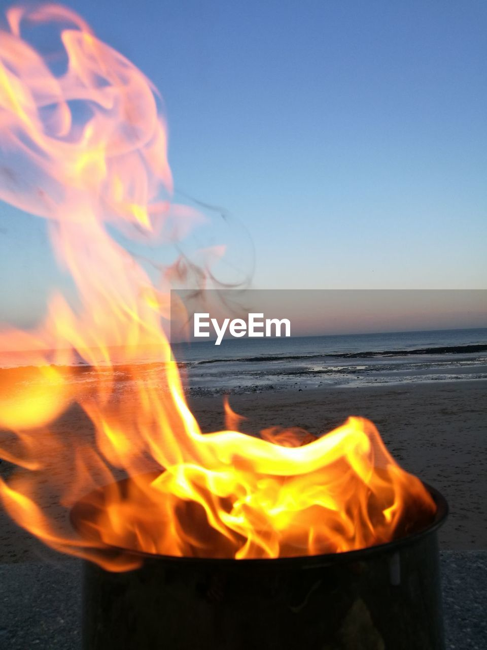 burning, flame, fire, fire - natural phenomenon, heat - temperature, nature, motion, water, orange color, sky, sea, land, beach, horizon over water, beauty in nature, blurred motion, sunset, yellow, glowing, no people, outdoors, bonfire