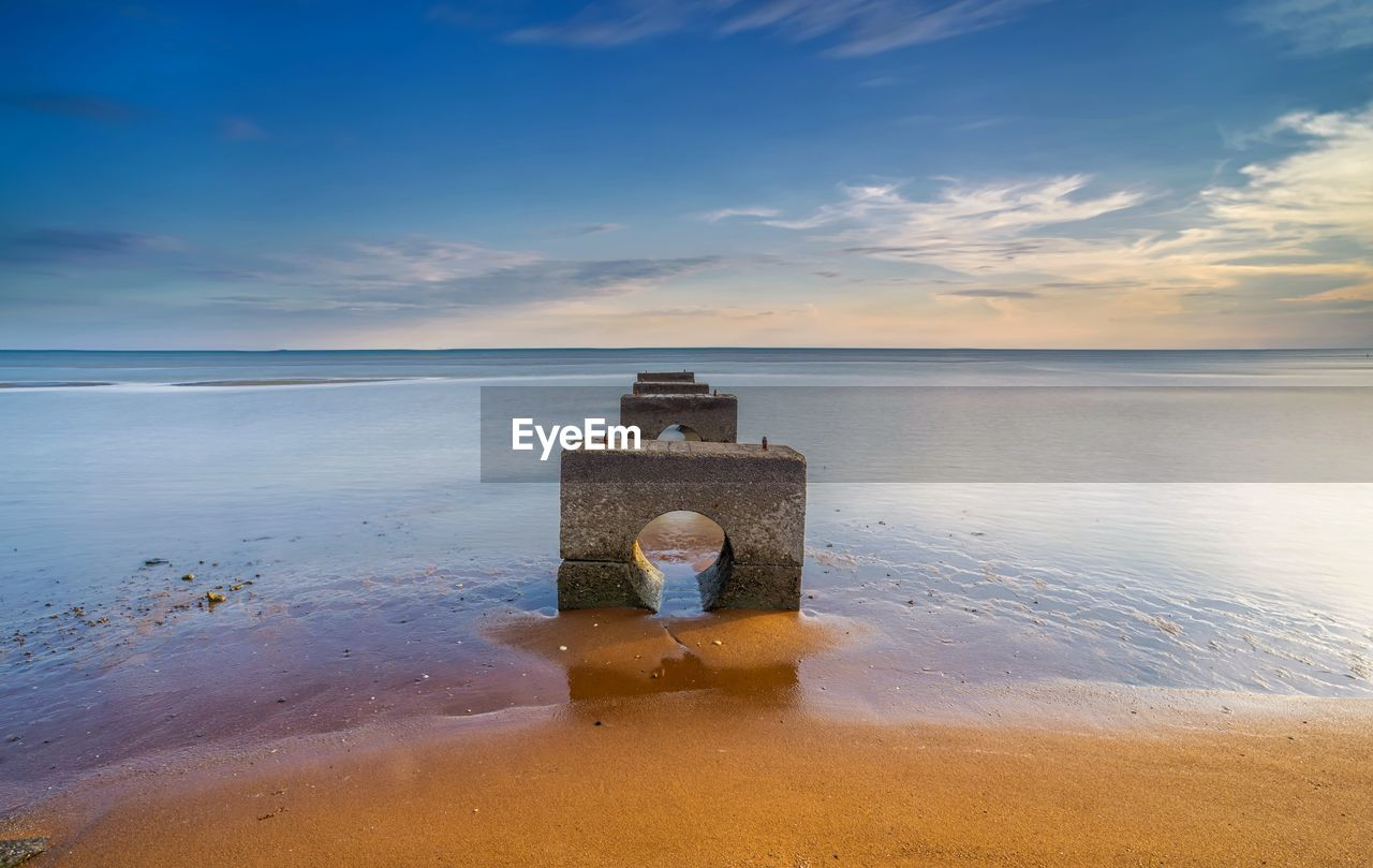 water, sky, cloud - sky, sea, scenics - nature, horizon over water, beauty in nature, tranquility, horizon, tranquil scene, nature, sunset, idyllic, land, no people, outdoors, beach, non-urban scene, architecture