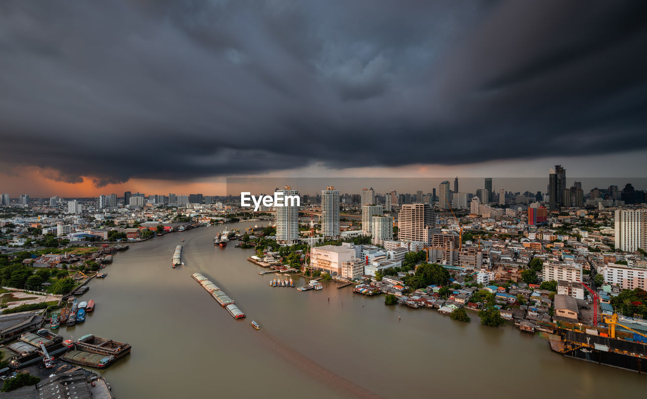 River Against Cloudy Sky In City