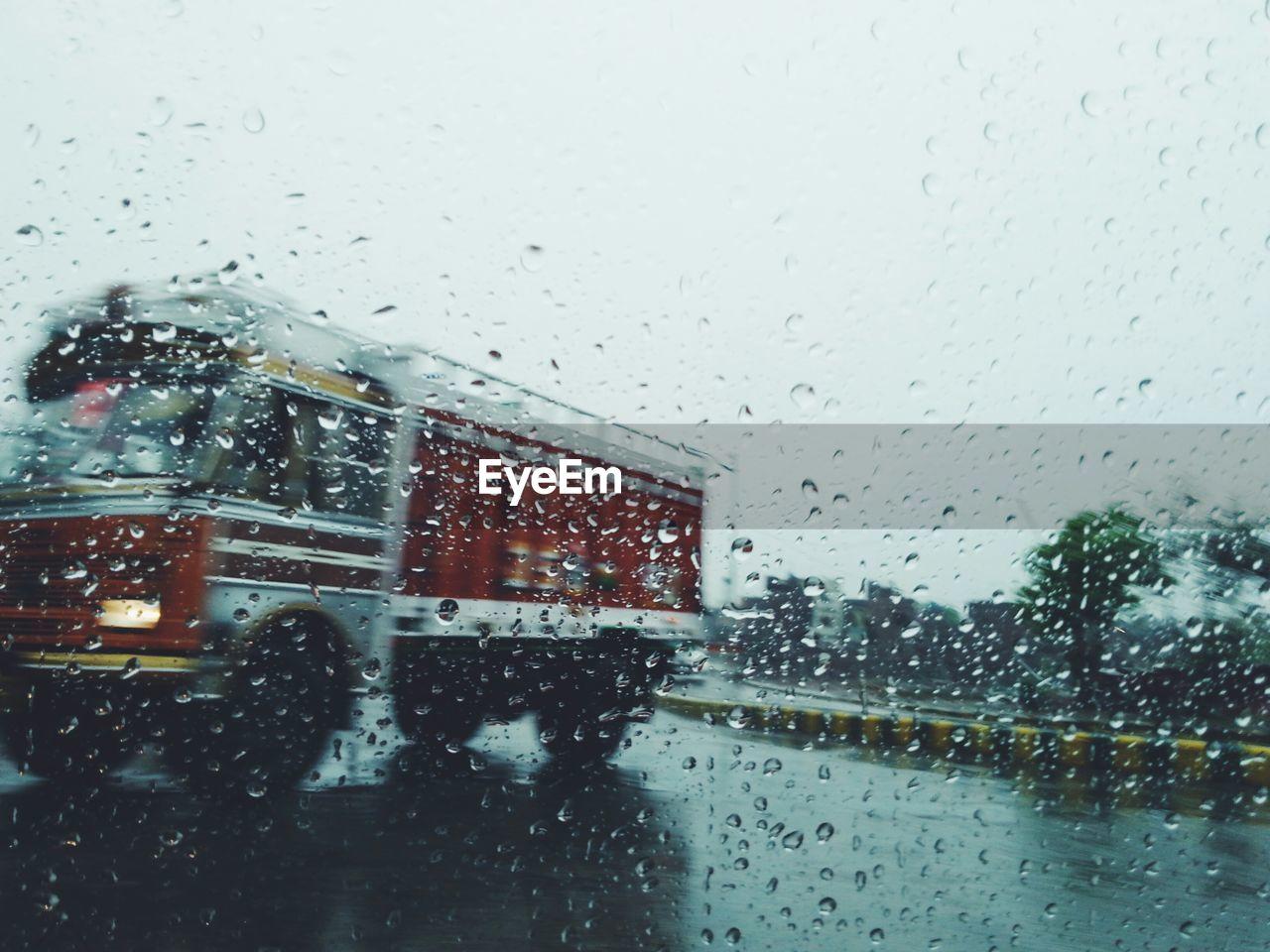 Truck seen from wet window