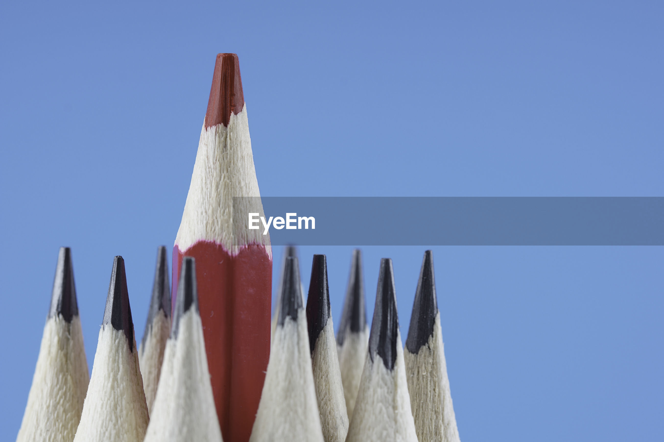 Close-up of pencils against blue background