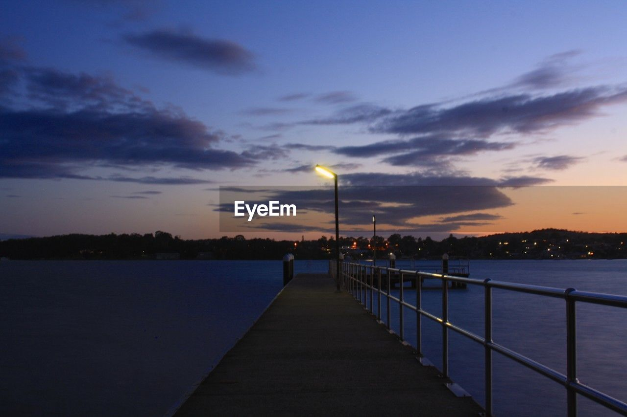 sky, water, pier, cloud - sky, sunset, tranquil scene, nature, beauty in nature, dusk, scenics, railing, tranquility, jetty, outdoors, lake, street light, night, moon, no people, built structure