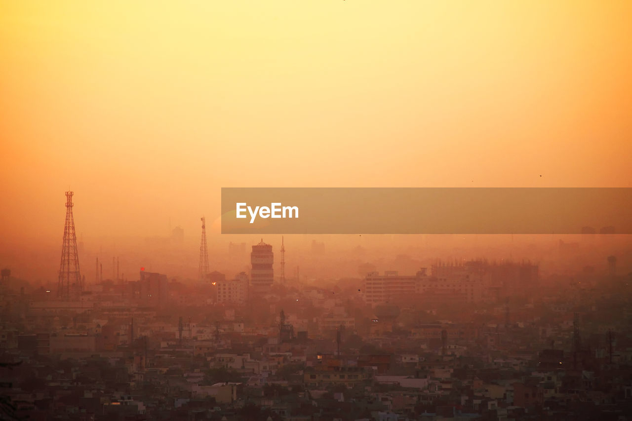 Aerial View Of Cityscape Against Clear Sky During Sunset