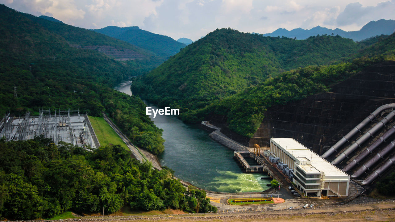 water, mountain, plant, tree, nature, transportation, no people, day, hydroelectric power, architecture, dam, fuel and power generation, high angle view, environment, river, mountain range, beauty in nature, built structure, scenics - nature, outdoors