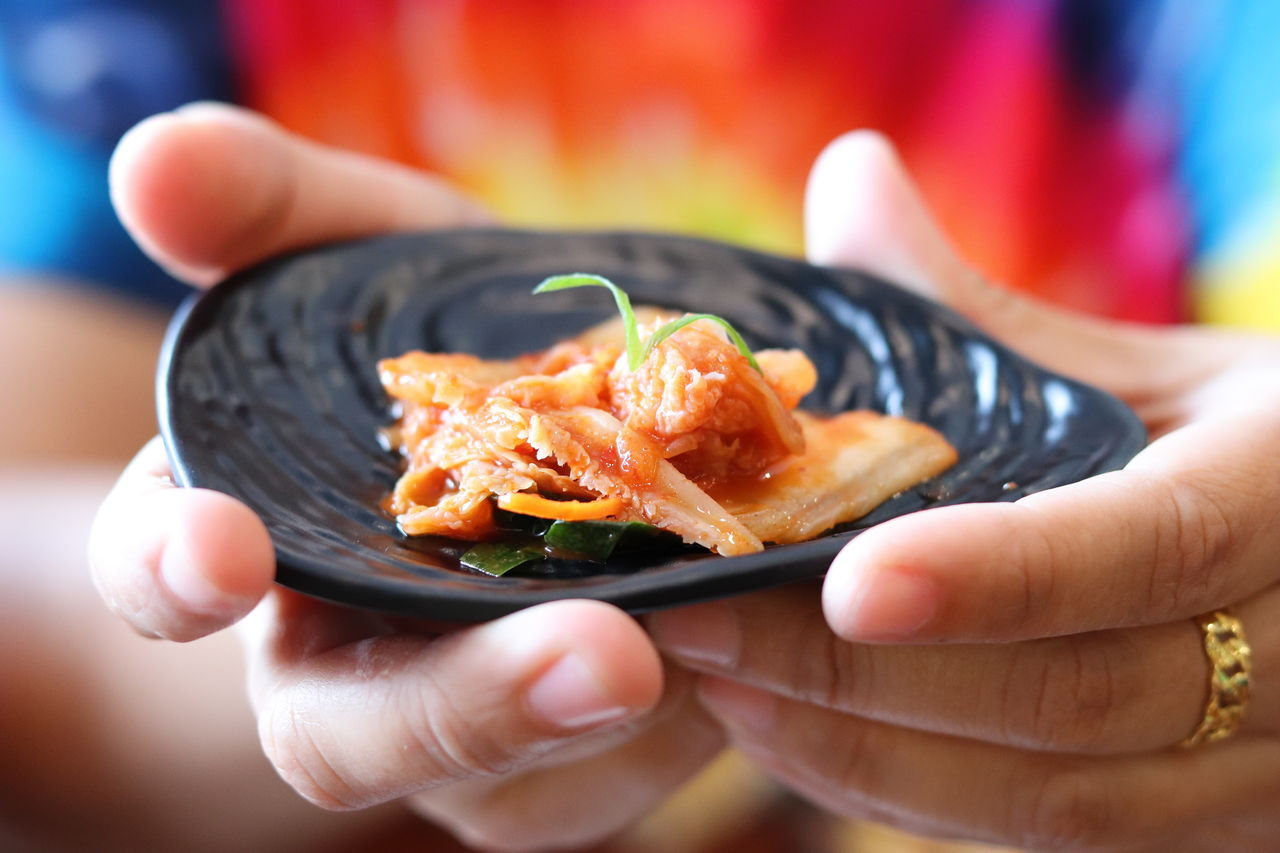 human hand, hand, human body part, food, holding, food and drink, one person, unrecognizable person, real people, freshness, body part, human finger, finger, ready-to-eat, lifestyles, close-up, focus on foreground, wellbeing, healthy eating, japanese food