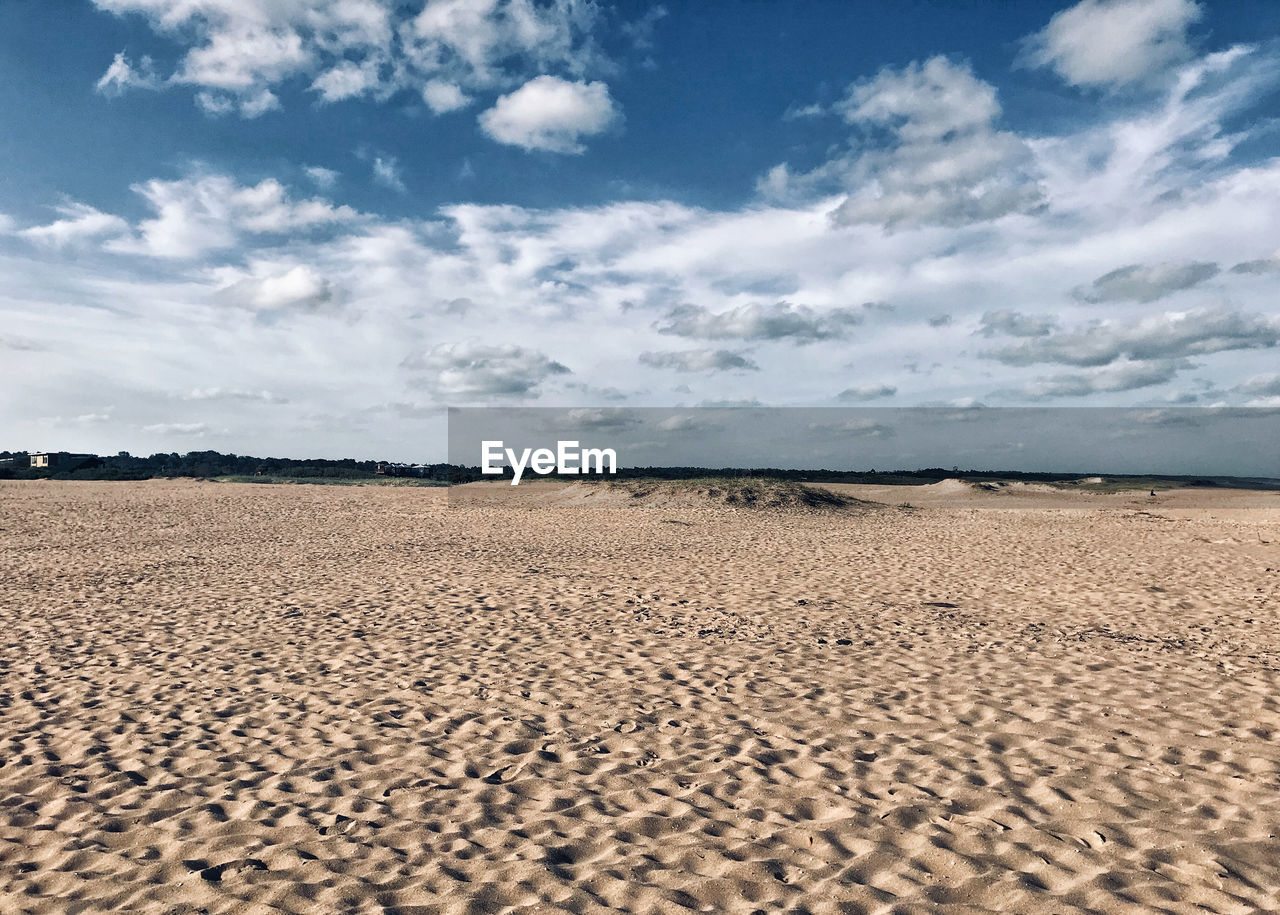 sky, land, cloud - sky, sand, scenics - nature, tranquil scene, beauty in nature, tranquility, environment, day, landscape, nature, horizon, no people, desert, non-urban scene, horizon over land, beach, outdoors, arid climate, climate, surface level