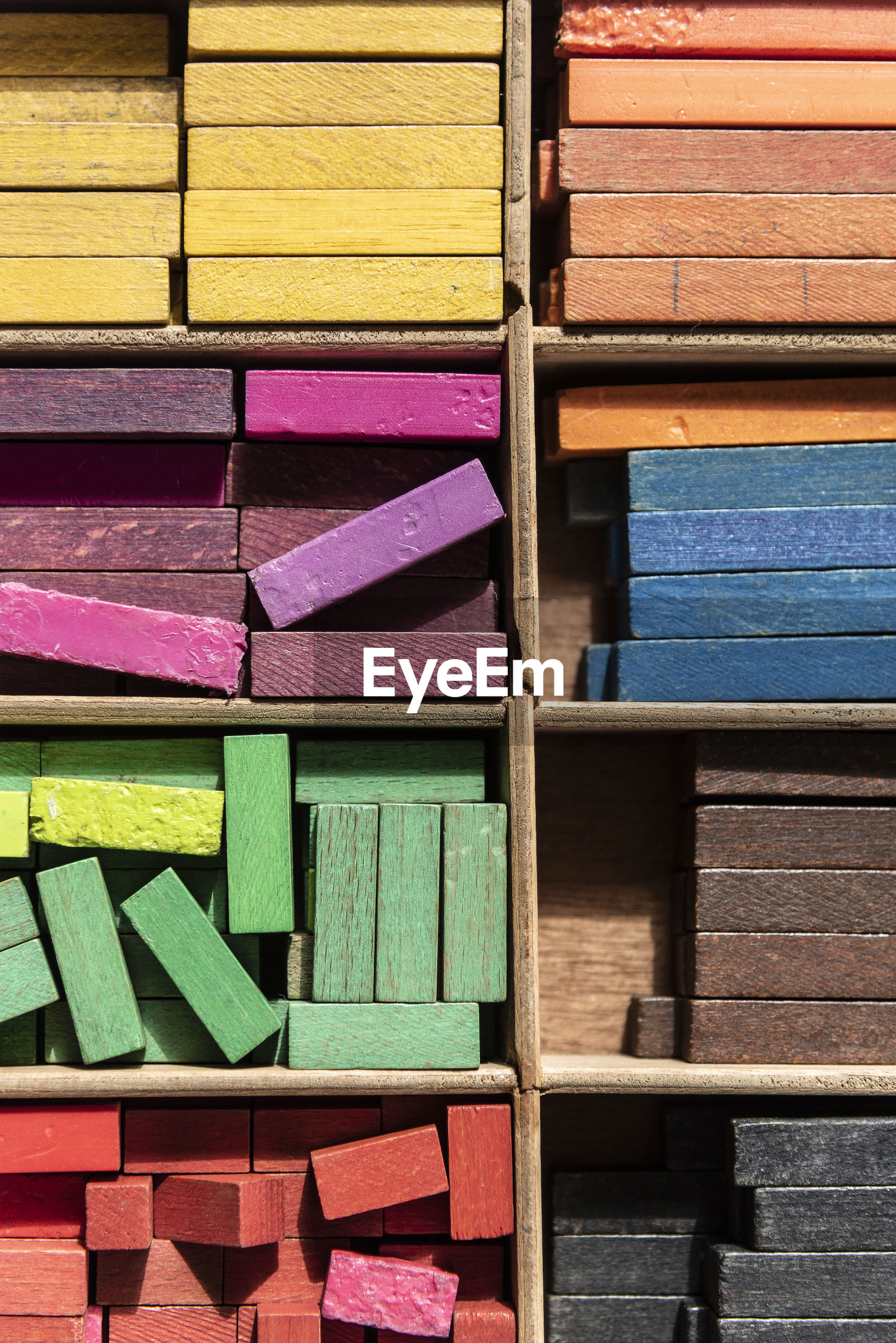 Full frame shot of colorful wooden blocks in container