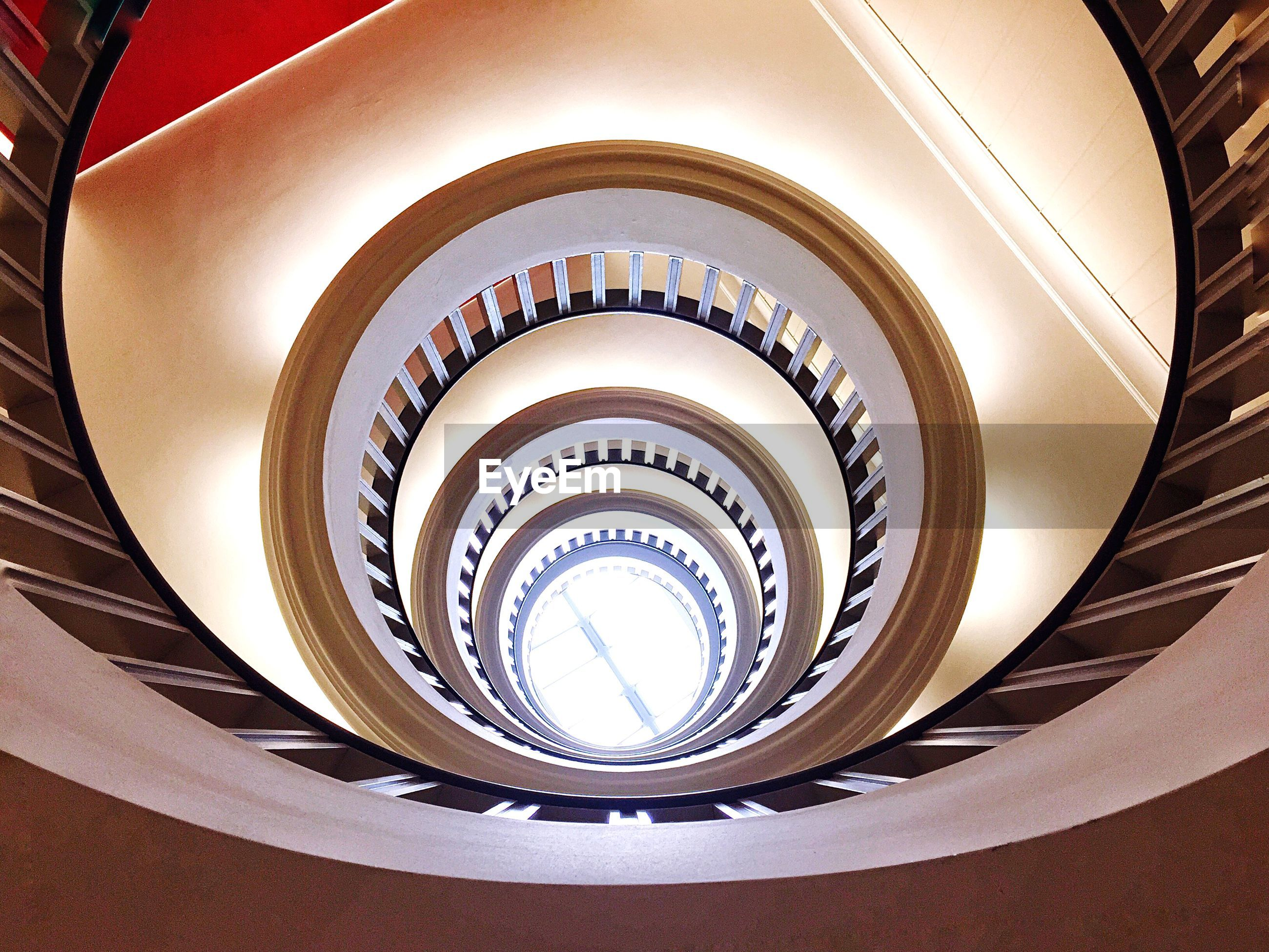 Low angle view of spiral staircase with sunlight