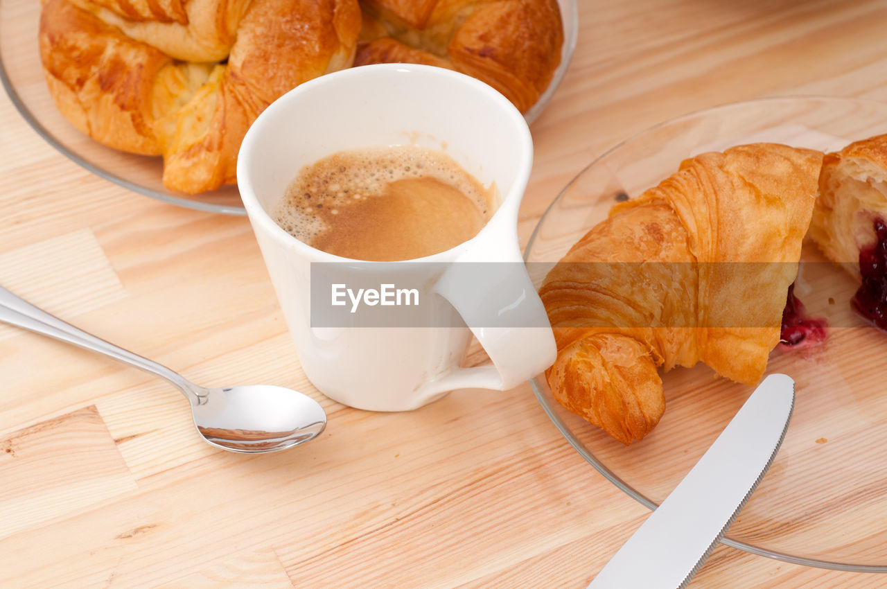 High Angle View Of Latte And Croissants On Table