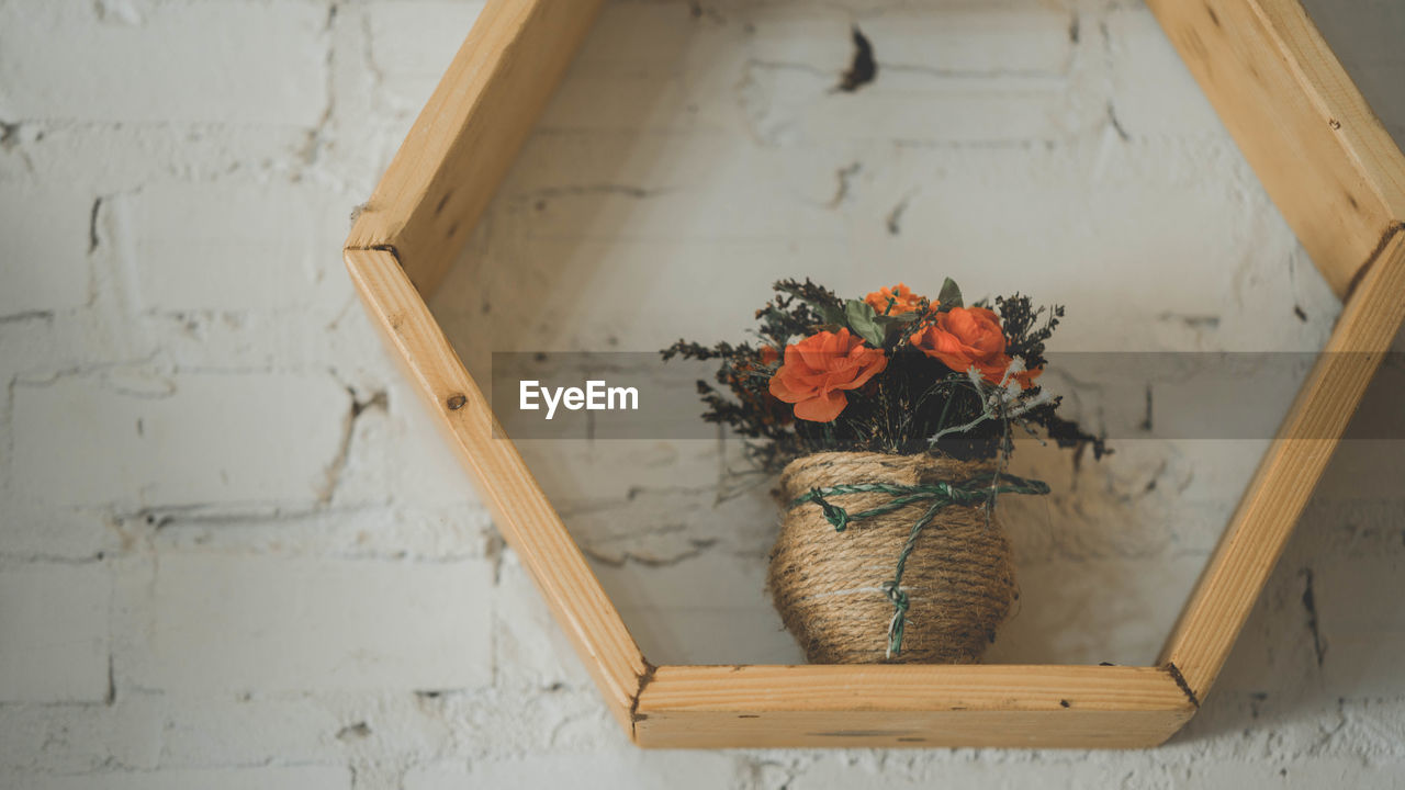 wood - material, flower, flowering plant, plant, no people, indoors, container, nature, architecture, beauty in nature, still life, table, close-up, high angle view, wall - building feature, freshness, art and craft, day, fragility, flower arrangement