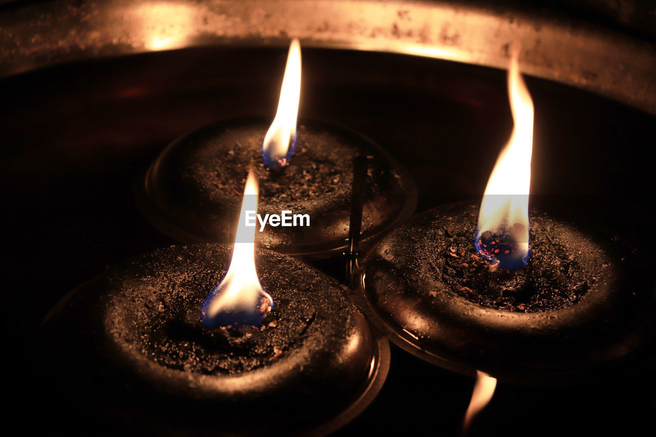 flame, heat - temperature, burning, fire, illuminated, fire - natural phenomenon, glowing, close-up, indoors, nature, no people, oil lamp, candle, lighting equipment, environment, focus on foreground, dark, electric lamp, diya - oil lamp, metal, melting