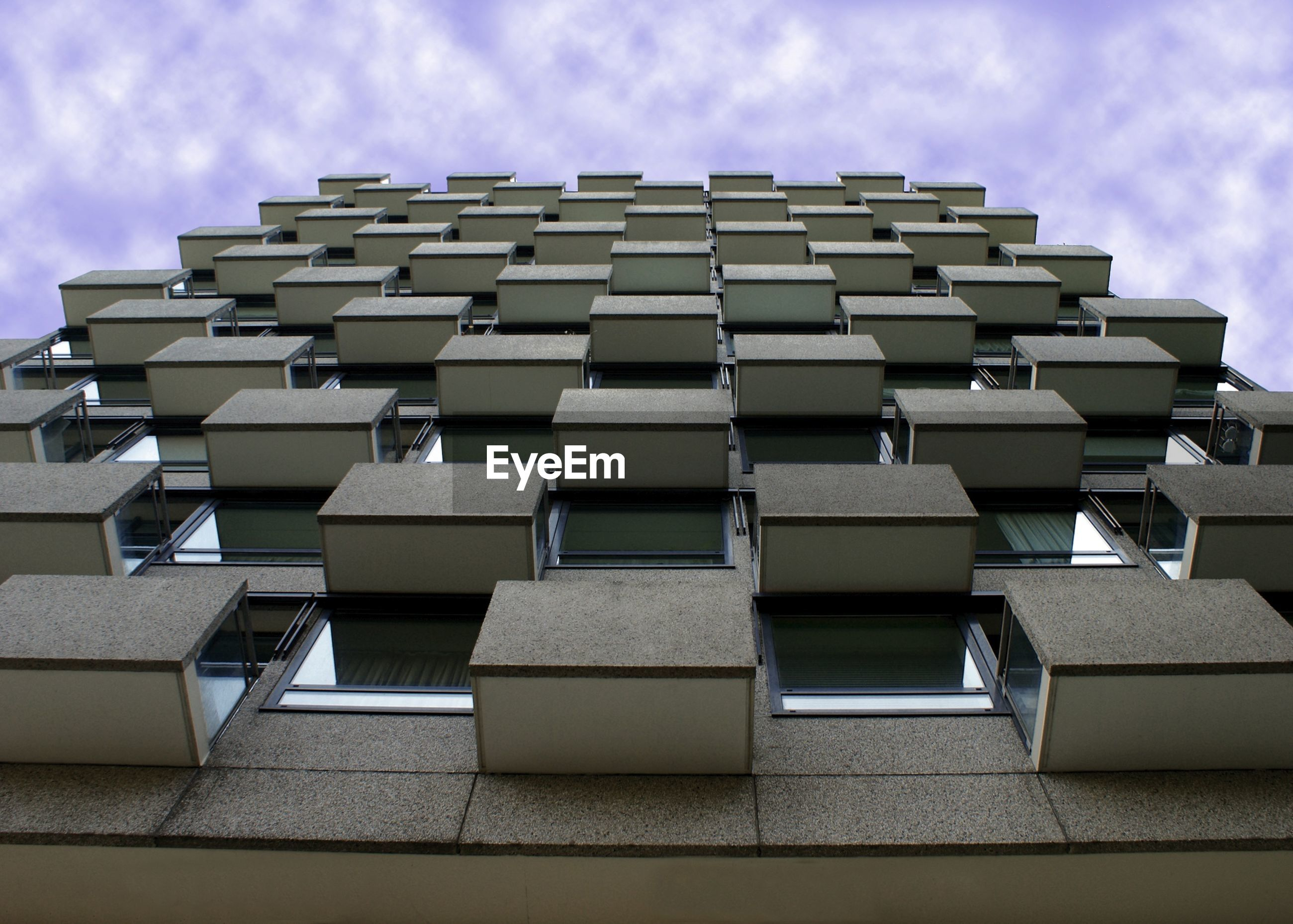 building exterior, architecture, built structure, sky, low angle view, repetition, in a row, modern, building, city, cloud - sky, office building, side by side, cloud, day, pattern, outdoors, no people, window, architectural feature