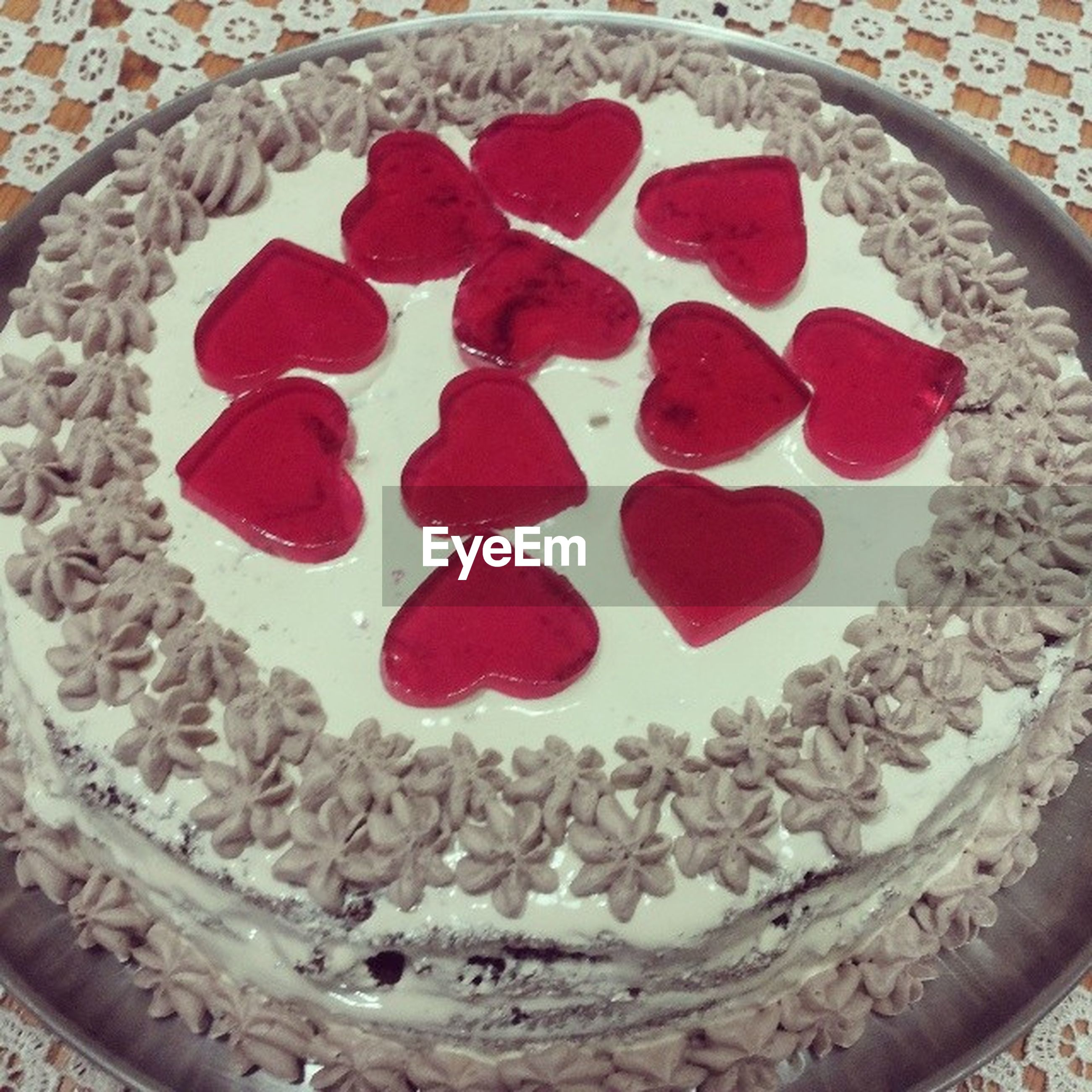 red, indoors, food and drink, food, sweet food, freshness, high angle view, still life, dessert, close-up, unhealthy eating, indulgence, ready-to-eat, pattern, no people, decoration, temptation, cake, directly above, day